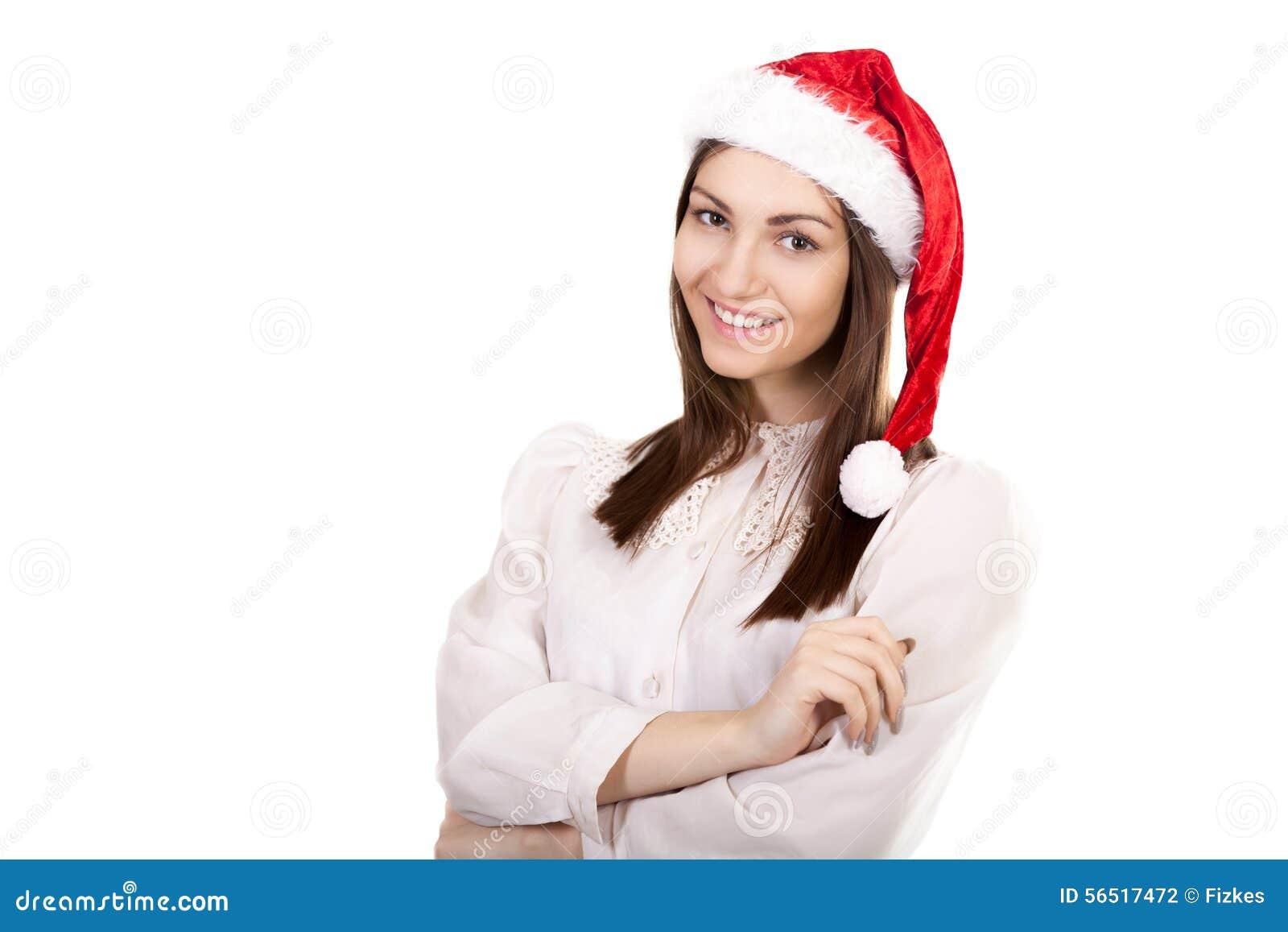 Jeune femme d affaires dans le chapeau rouge de Santa Claus sur le fond blanc