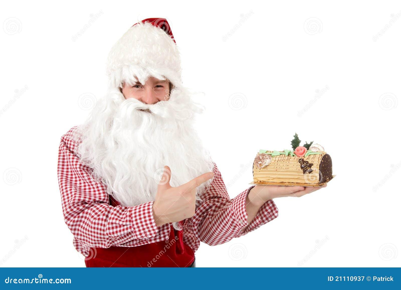 Jeune homme caucasien le père noël, gâteau