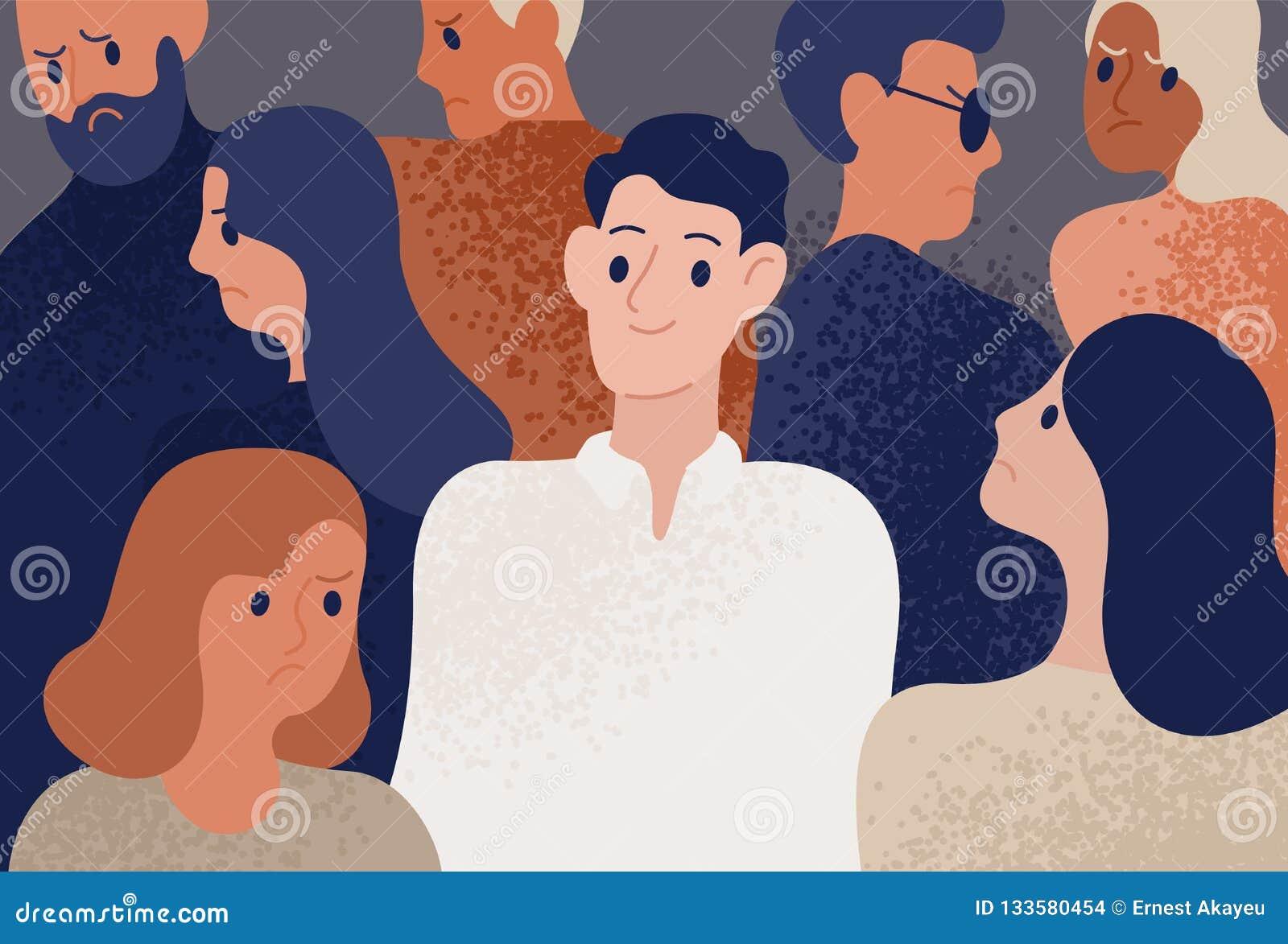 Jeune homme heureux et satisfaisant entouré par les personnes déprimées, malheureuses, tristes et fâchées Personne de sourire dan