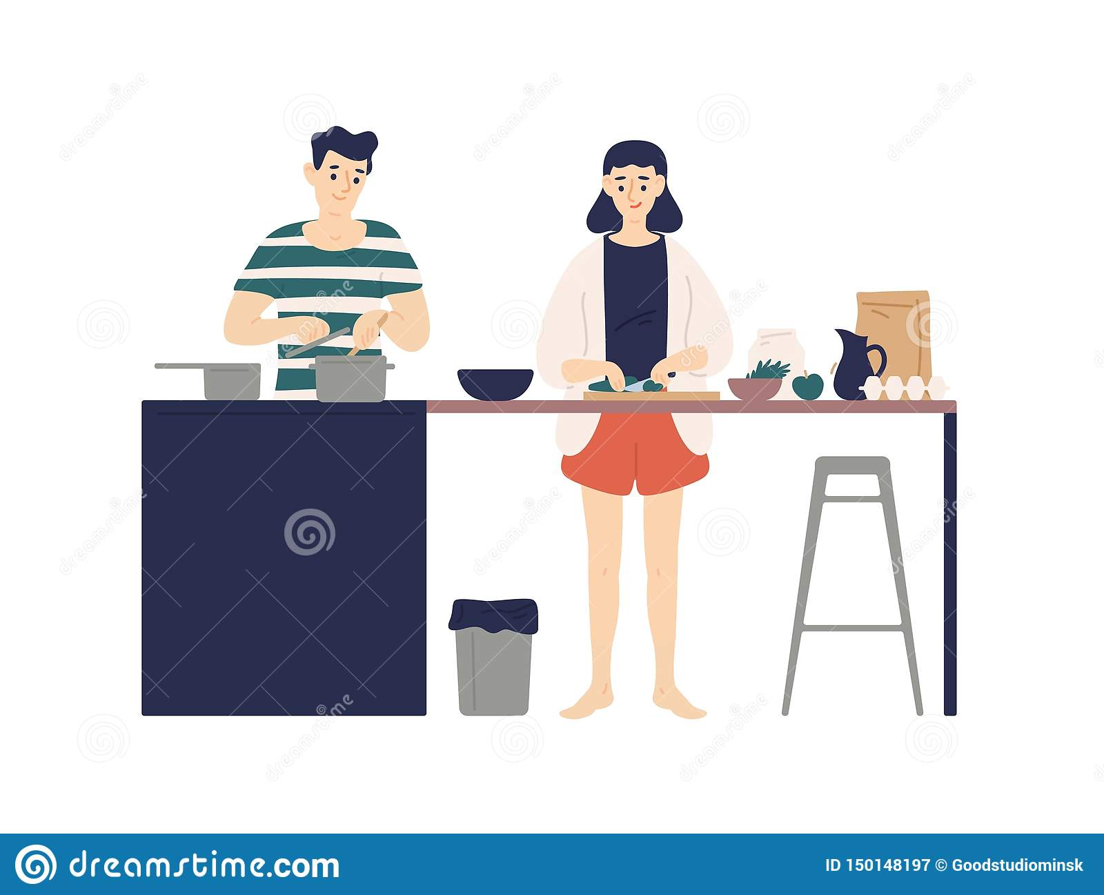 Jeune homme mignon et femme faisant cuire des repas dans la cuisine Garçon et fille de sourire faisant le déjeuner ou le dîner en
