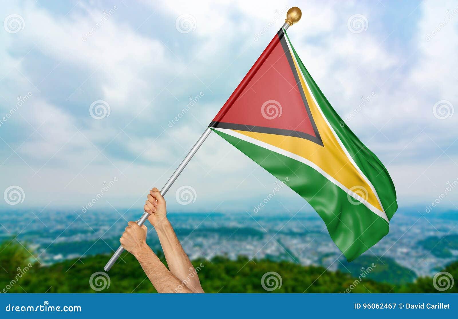 Jeune man& x27 ; s remet onduler fièrement la Guyane drapeau national dans le ciel, rendu de la partie 3D