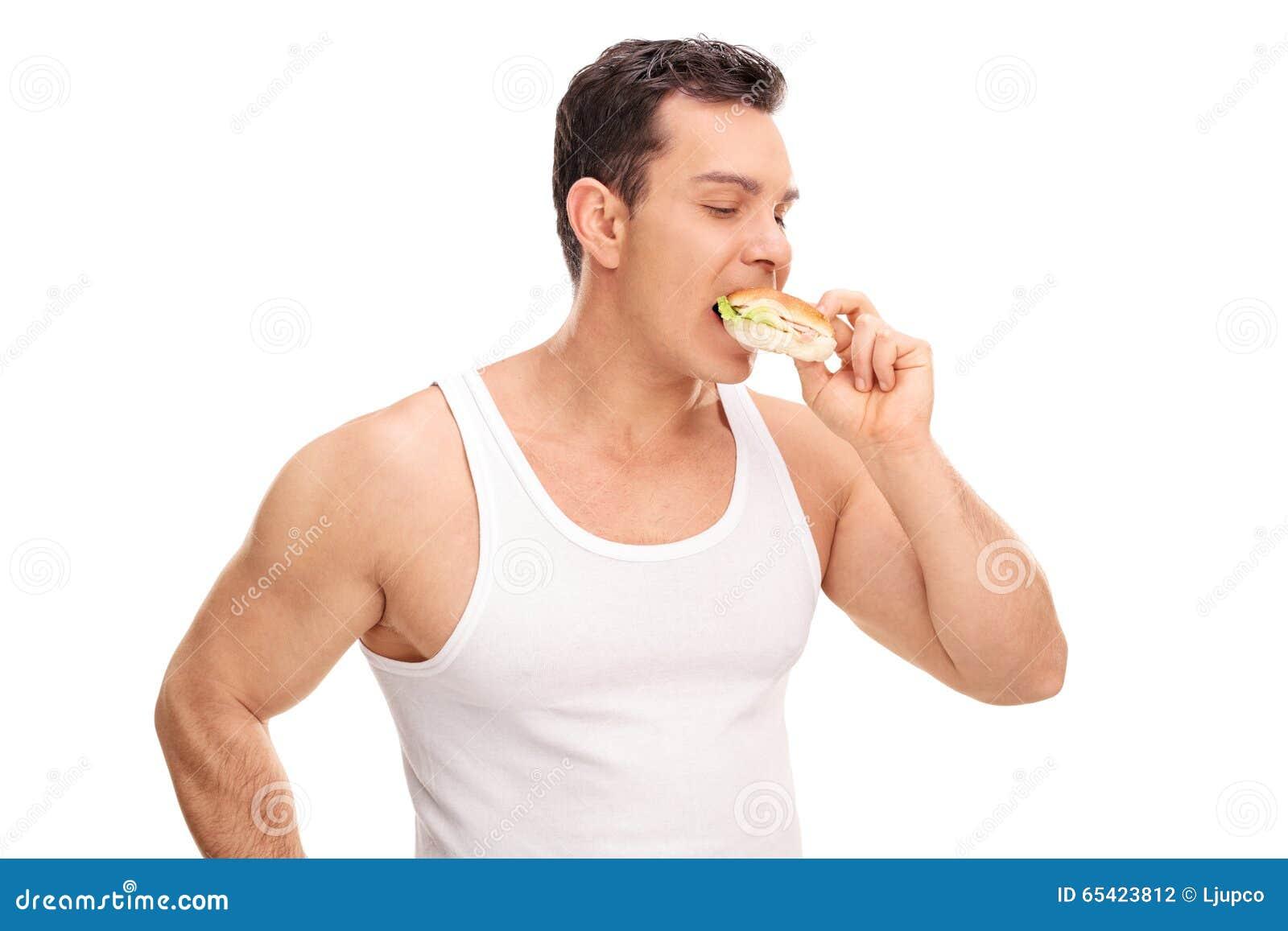 Jeune mangeur d hommes un sandwich