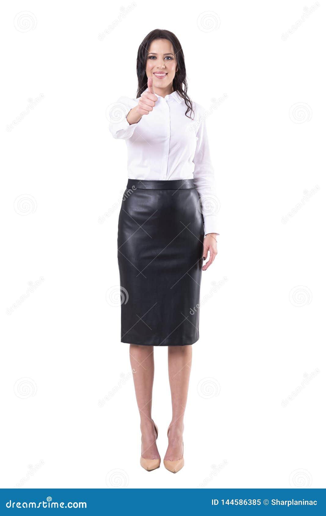 Jeune pouce adulte de sourire satisfaisant heureux d apparence de femme d affaires ? la cam?ra