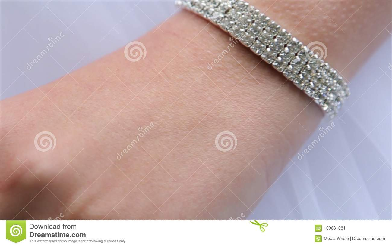 Jeweler Bracelet On The Bride`s Hand. Bride`s Hands With Ring ...