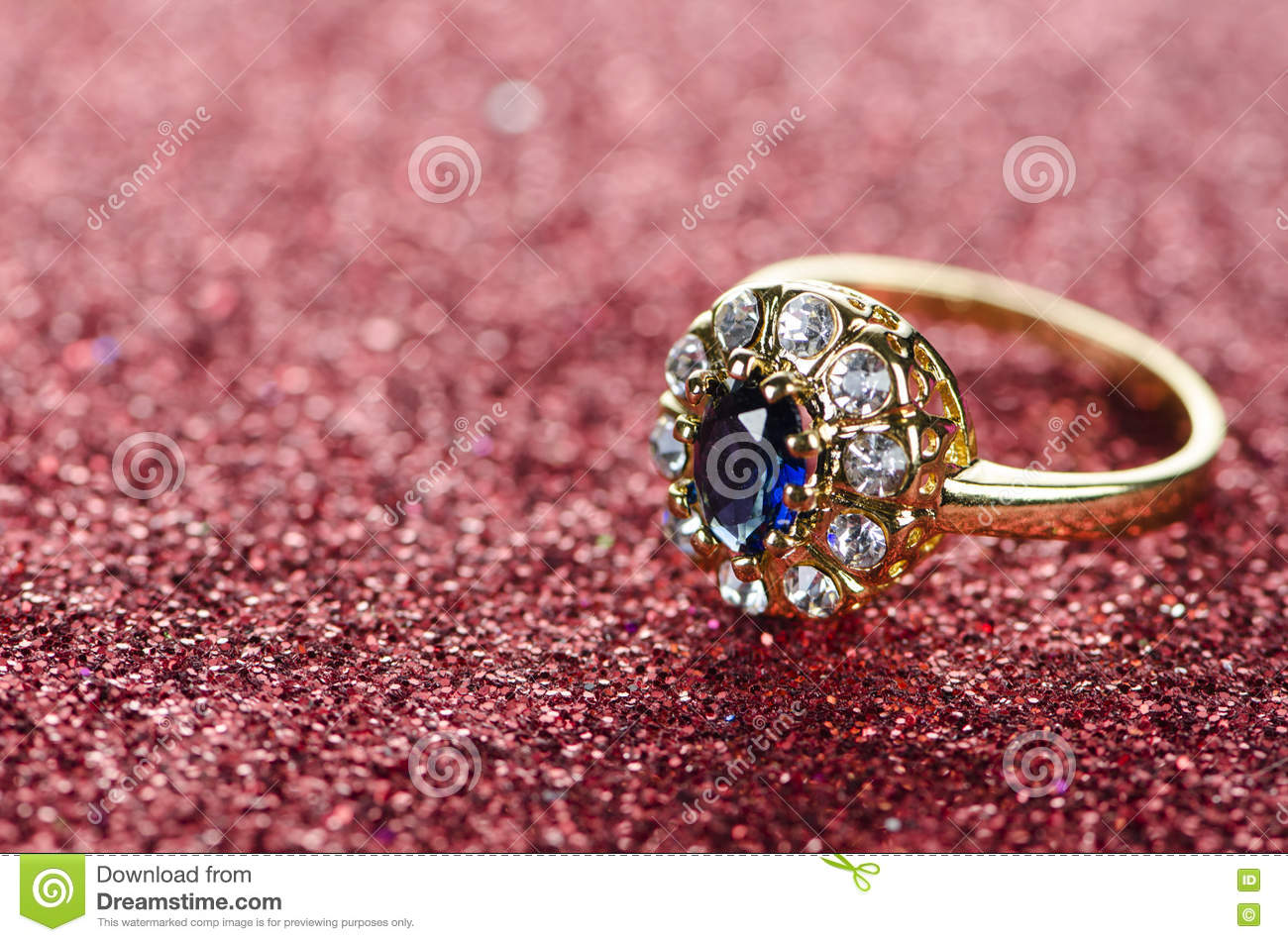 The jewellery ring against shiny background