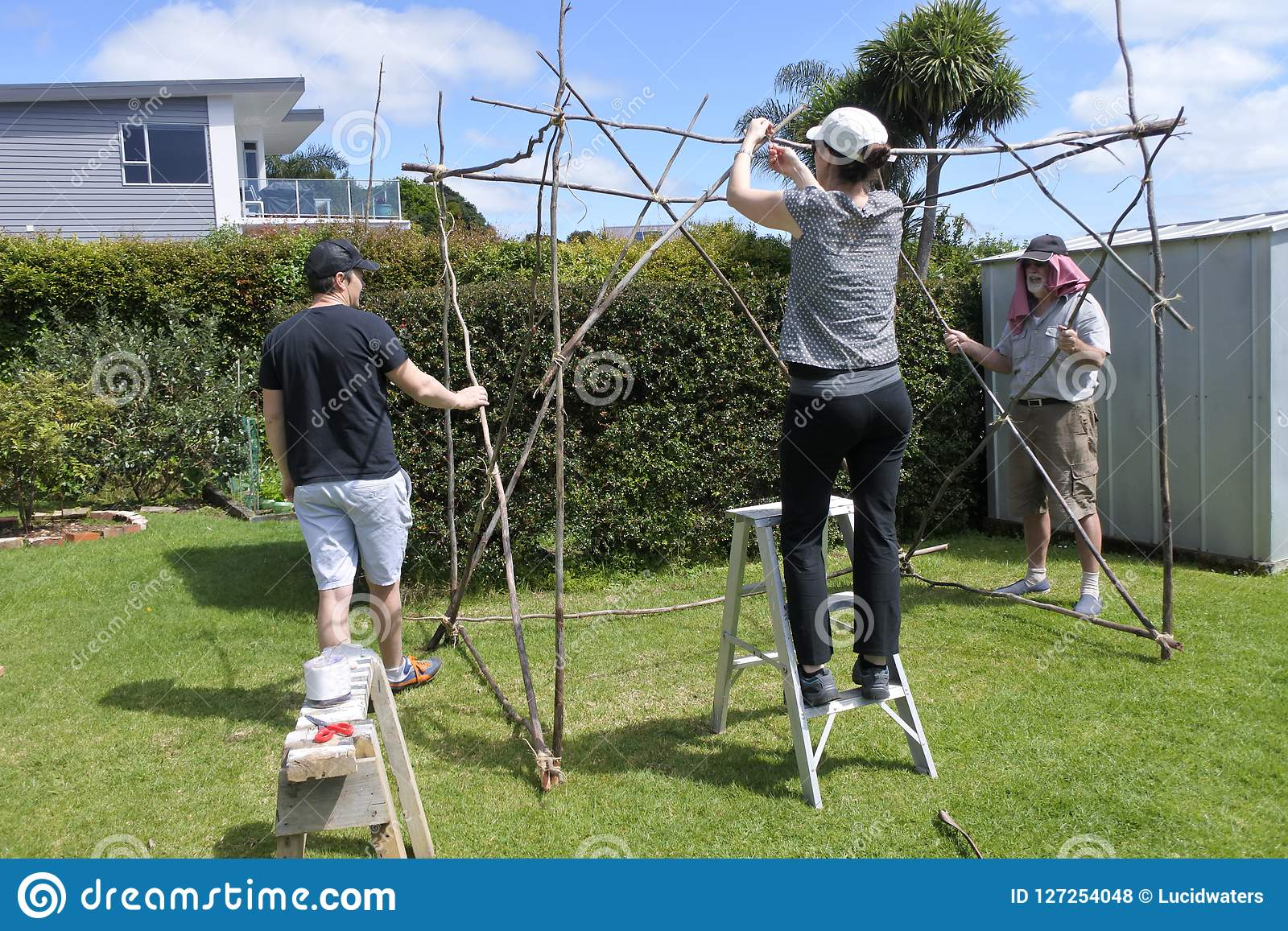 Jewish Family Building a Sukkah on Sukkoth Feast of Tabernacles