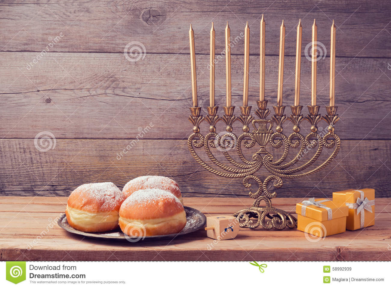 Jewish holiday Hanukkah celebration with vintage menorah over wooden background