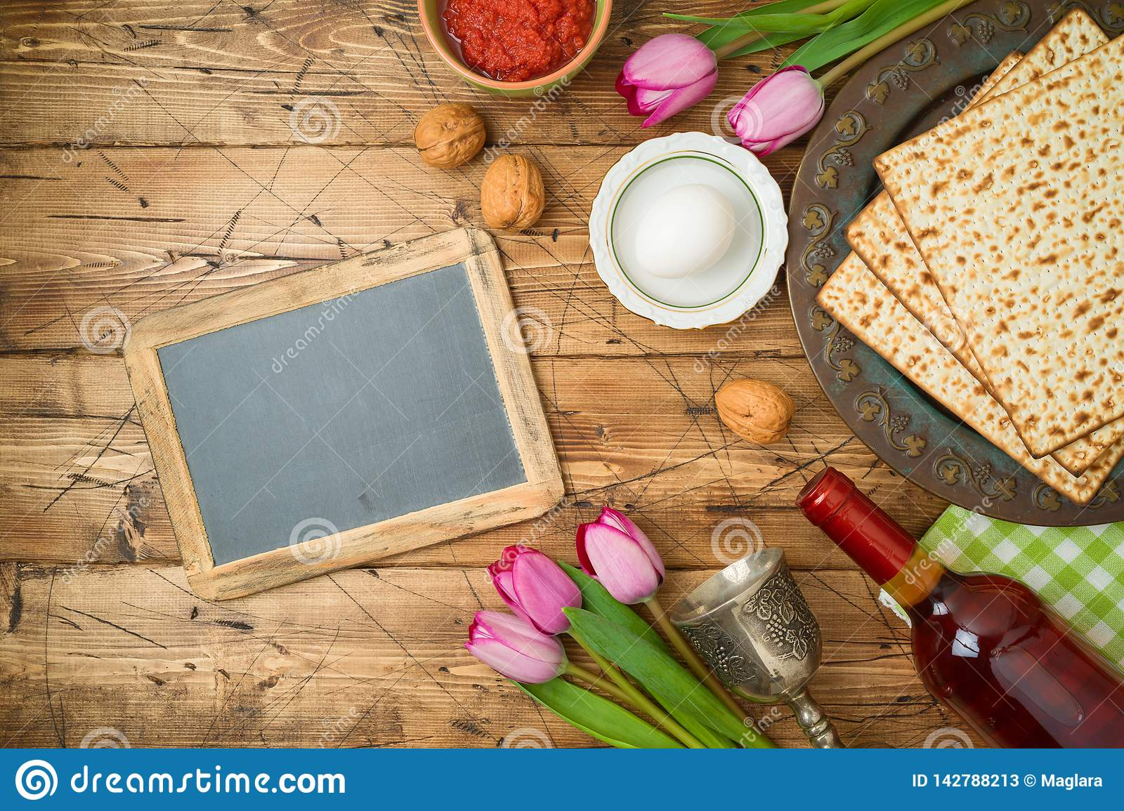 Jewish Holiday Passover Background With Matzo Seder Plate Wine Tulip Flowers And Chalkboard On Wooden Table Stock Image Image Of Celebration Decoration 142788213