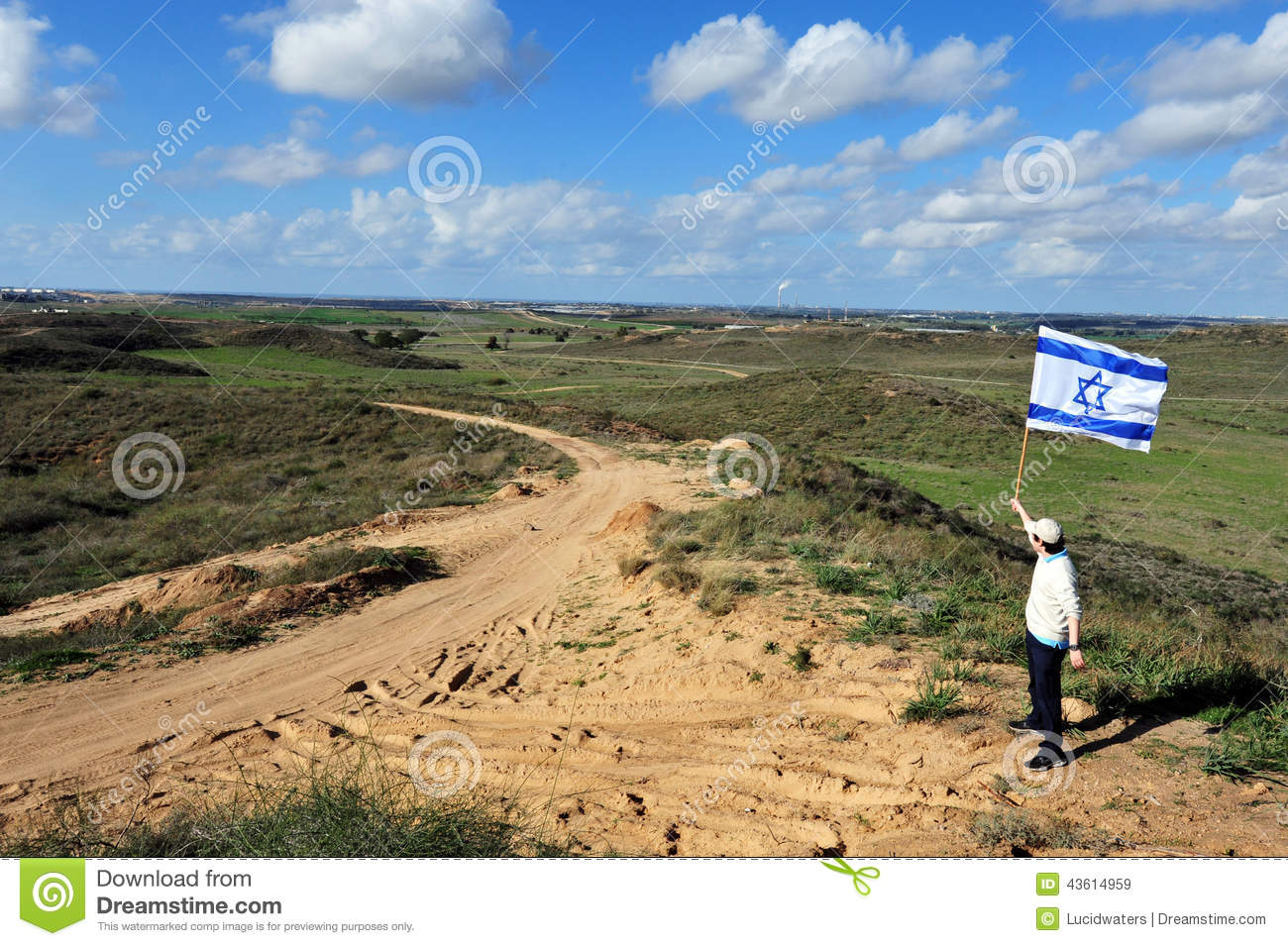 Jewish man fly flag of Israel near Gaza Strip
