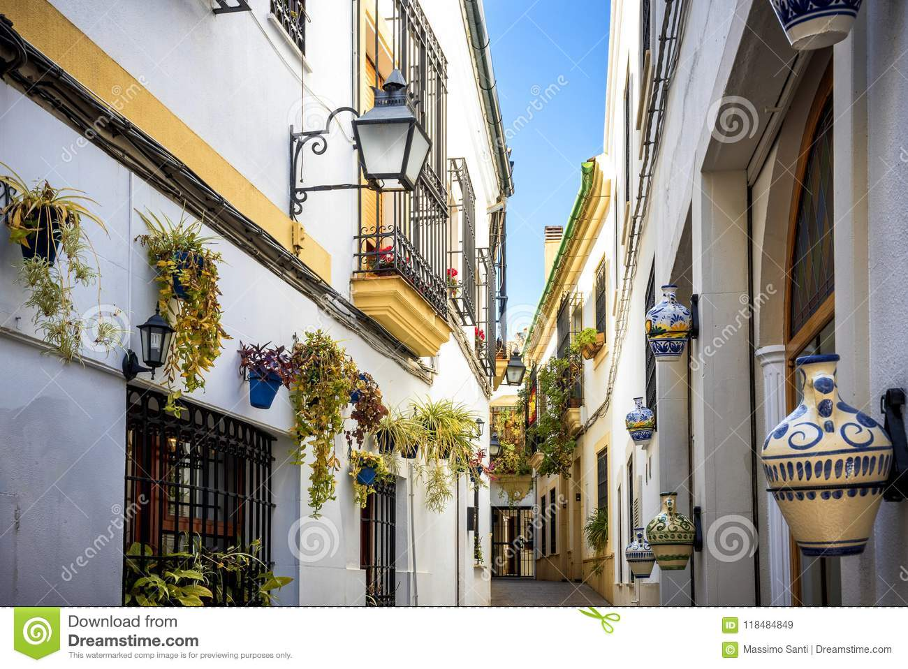 Cordoba: old typical street in the Juderia with plants and flowers. Andalucia, Spain.