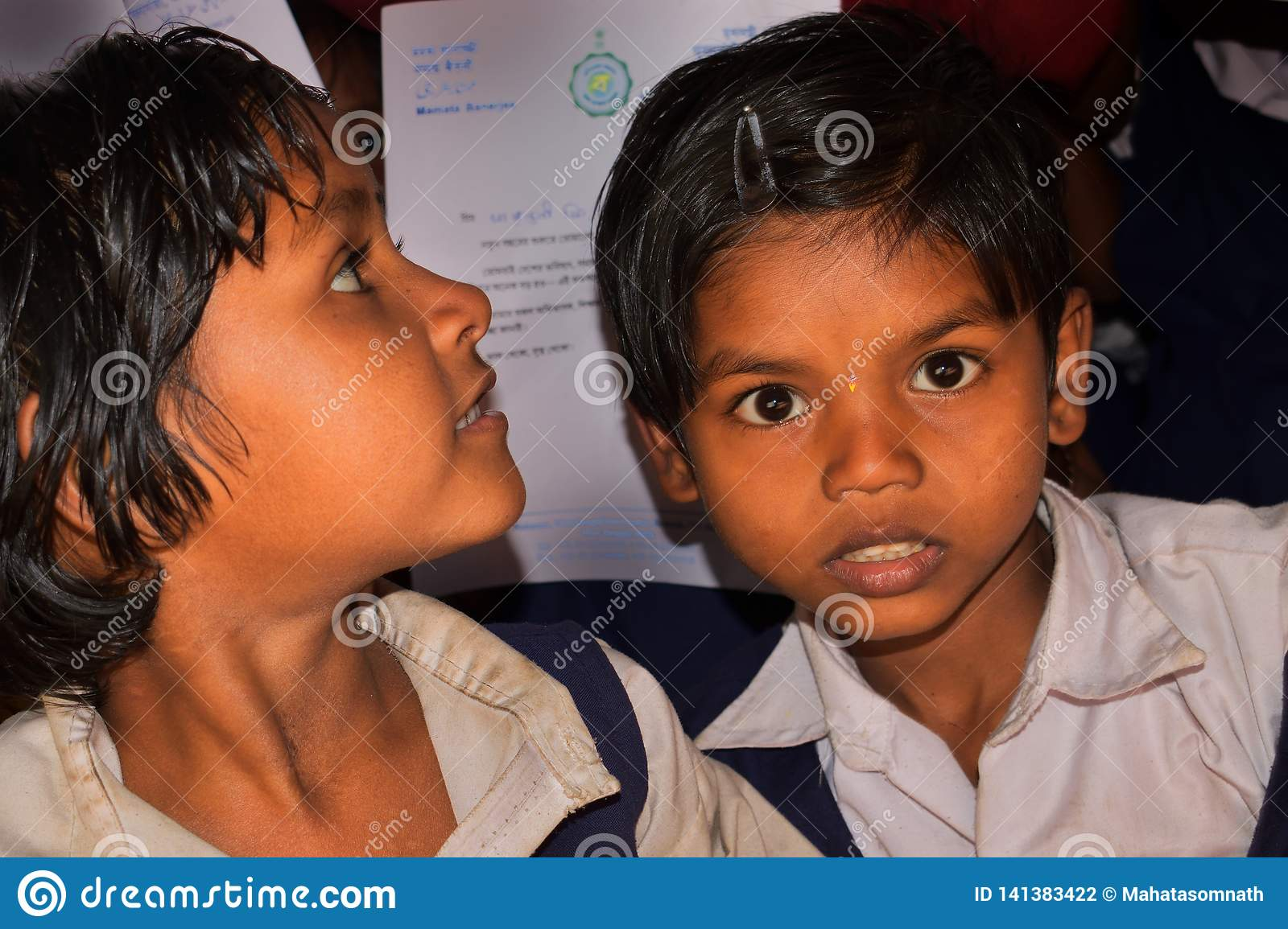 Two school girls from a rural primary school of Bengal, were looking towards the camera lens