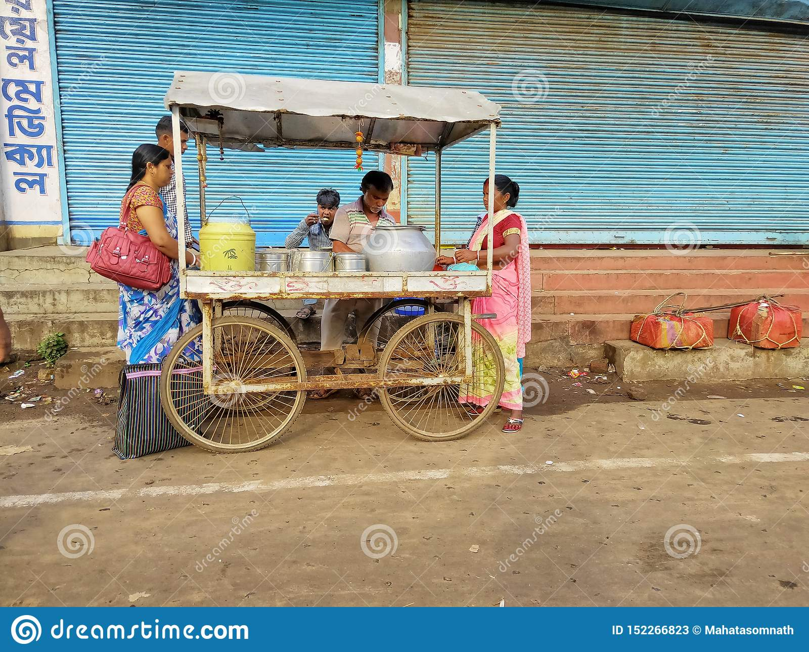 Jhargram, West Bengal, India - May 05, 2018: a street food vendor was selling edli, a south Indian food bedside the