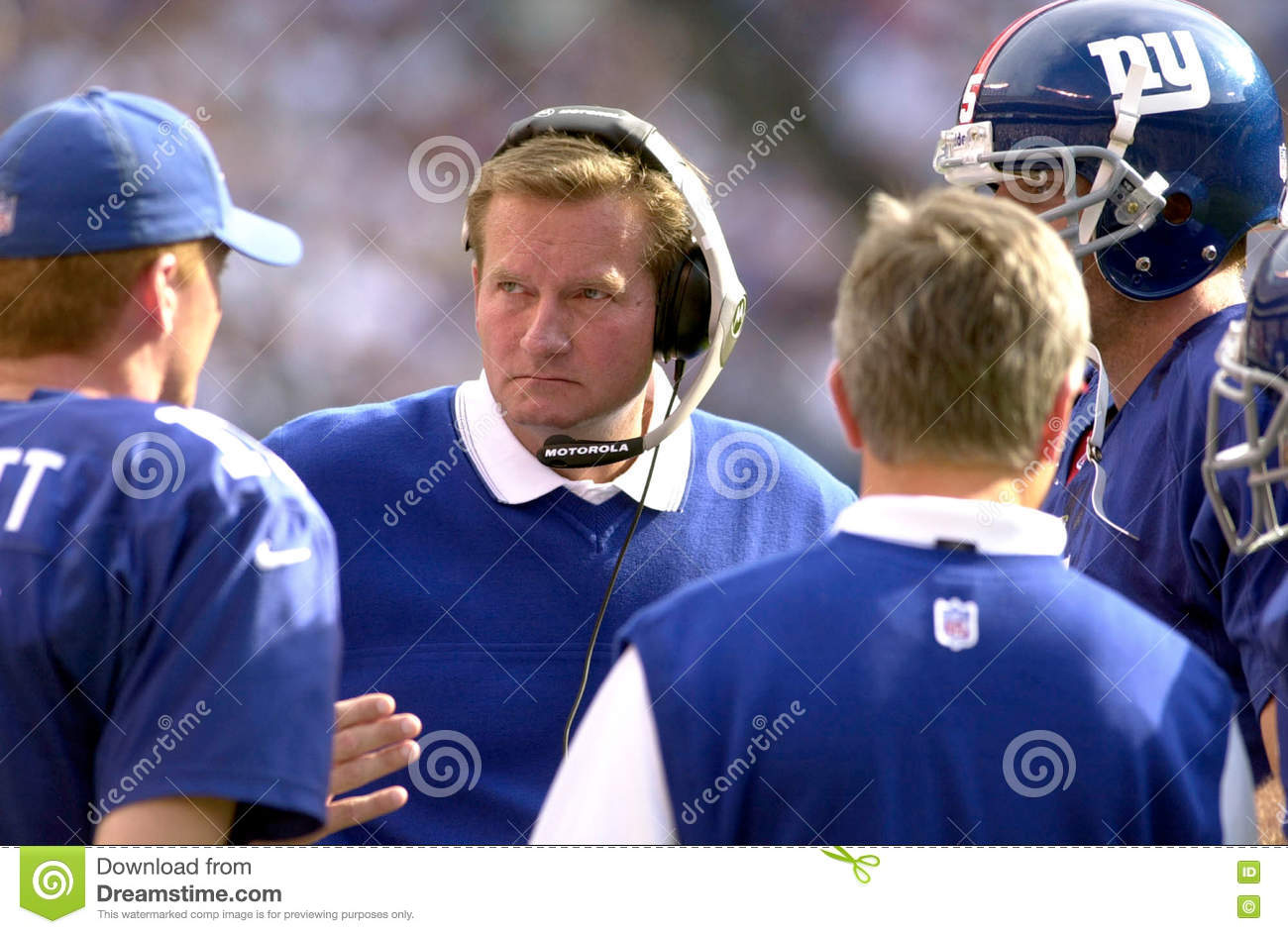 30da9018df5 Coach Jim Fassel of the New York Giants talks with players during a time  out againist the Dallas Cowboys. The New York Giants went on to defeat the  Dallas ...