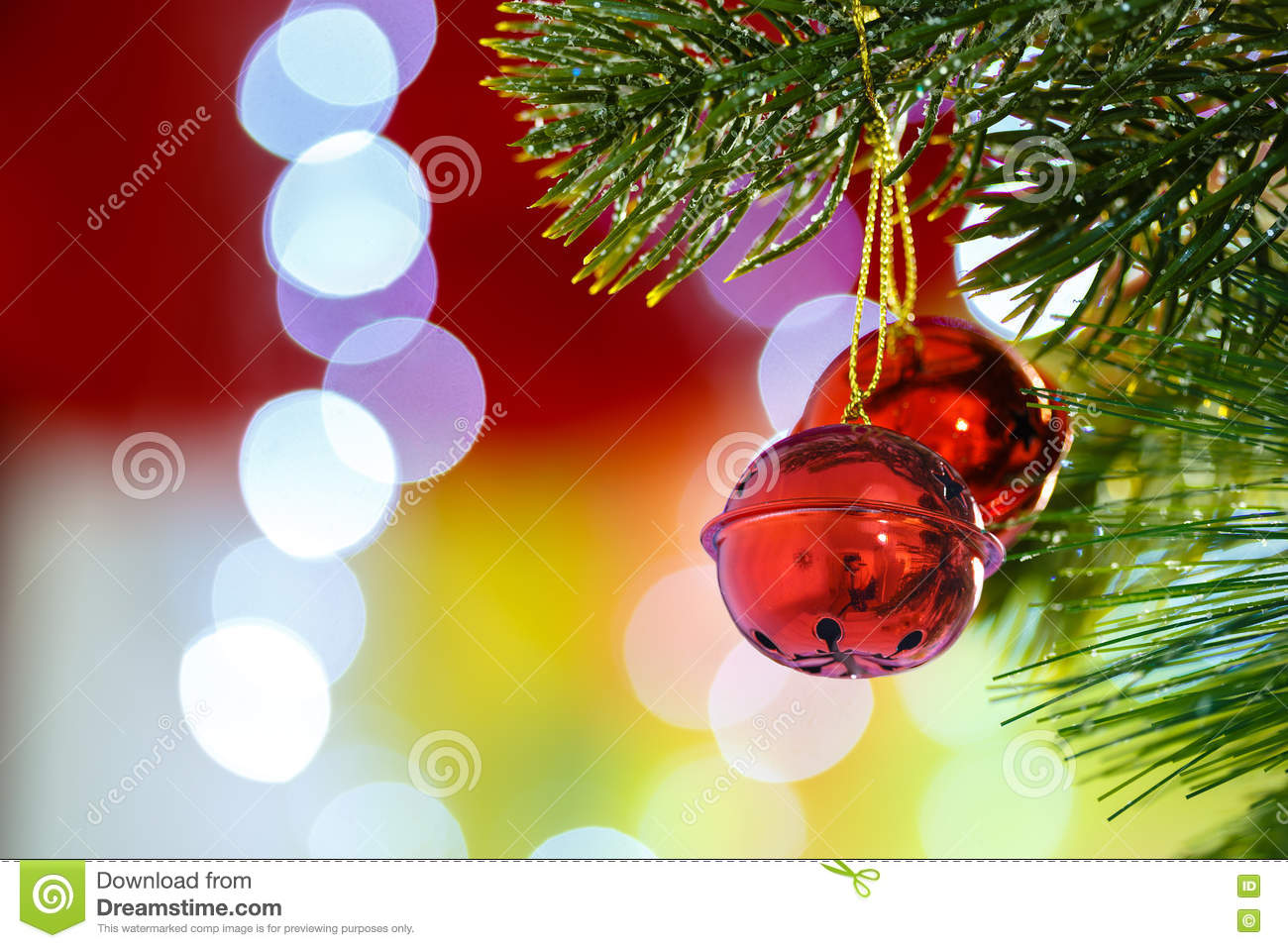 jingle bells on christmas tree with abstract light background