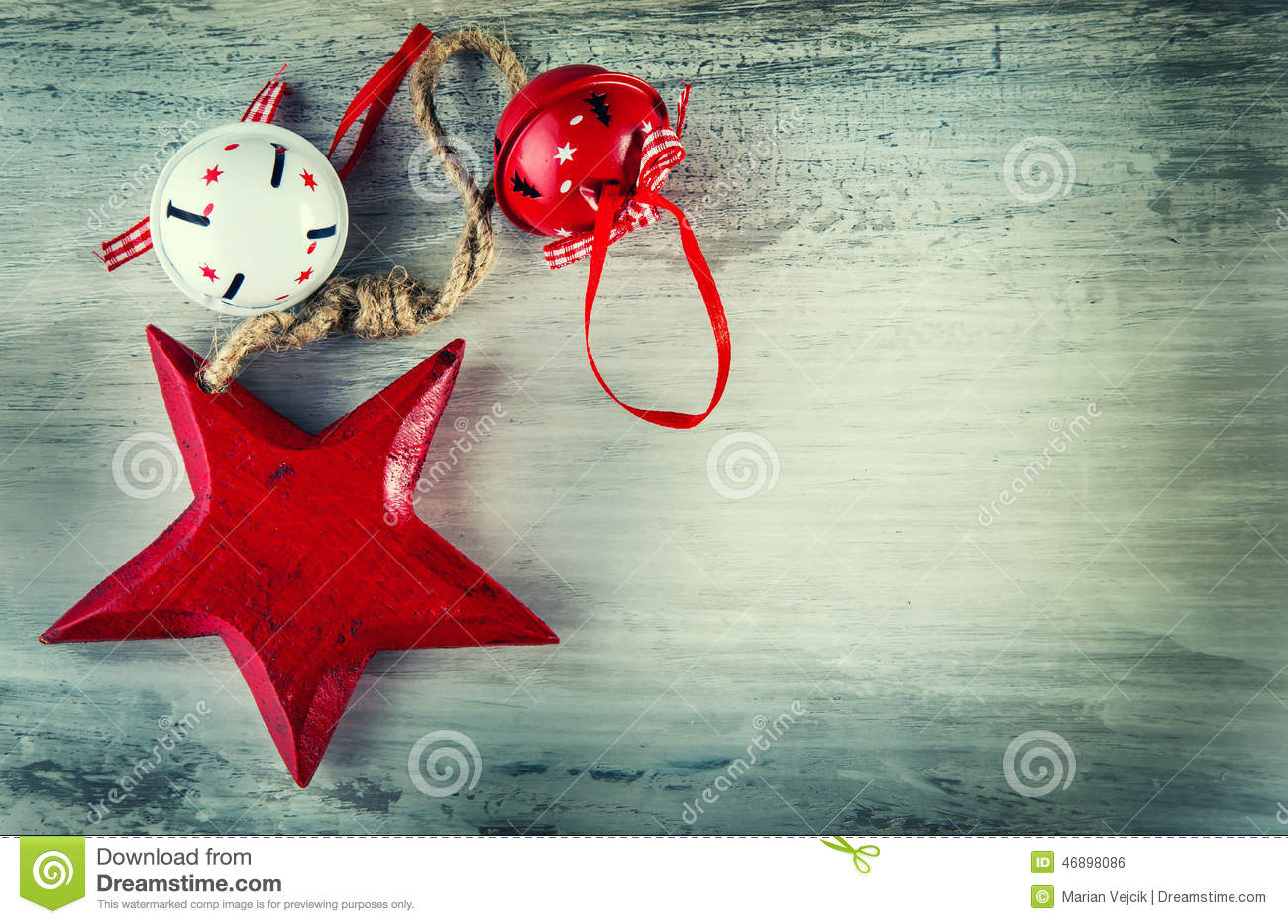 Jingle bells and wooden red star as christmas decorations