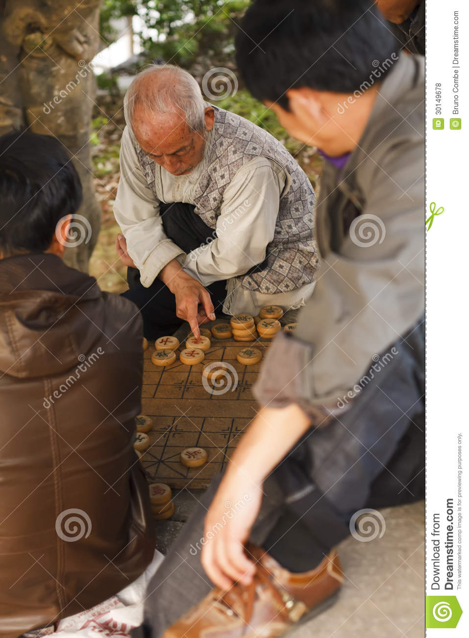 Thinking man during a game of Chinese chess