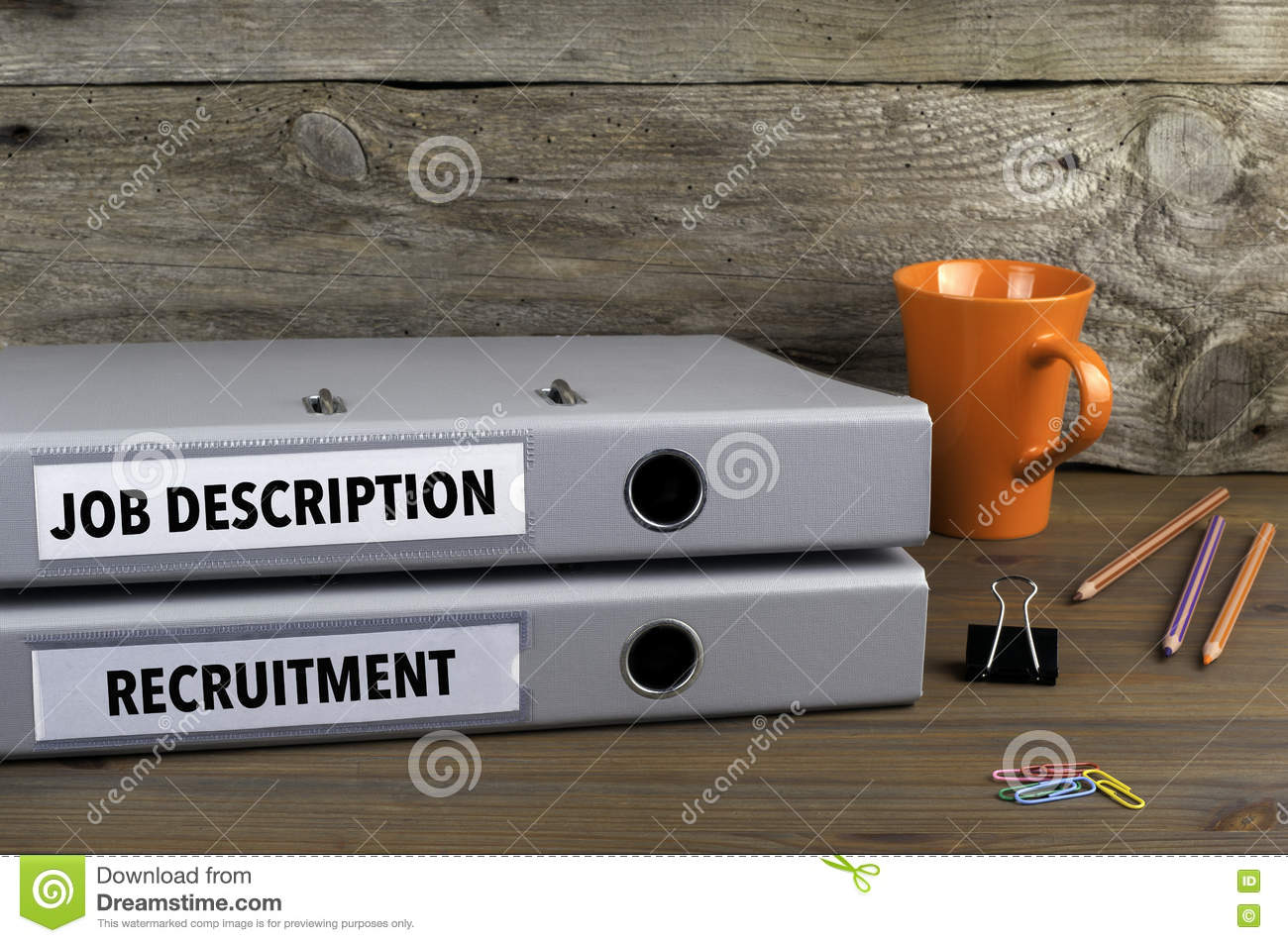Job Description and Recruitment - two folders on wooden office d