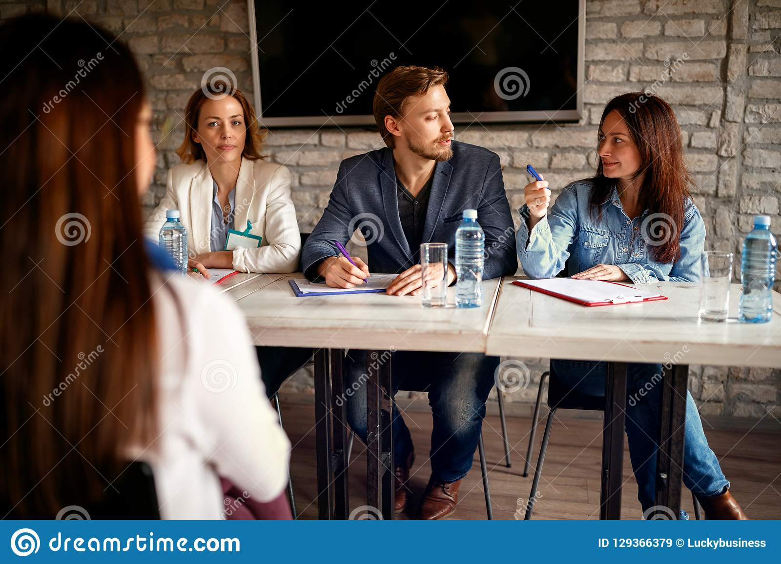Job interview with female candidate in modern office- business p