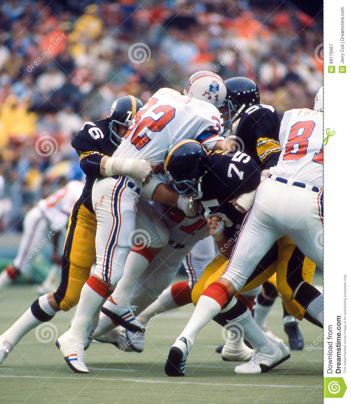 87a8cb8eb02 Steelers DE Joe Greene (75) with help from the Steel Curtain wrap up  Patriots running back Andy Johnson.(Image taken from color slide.)