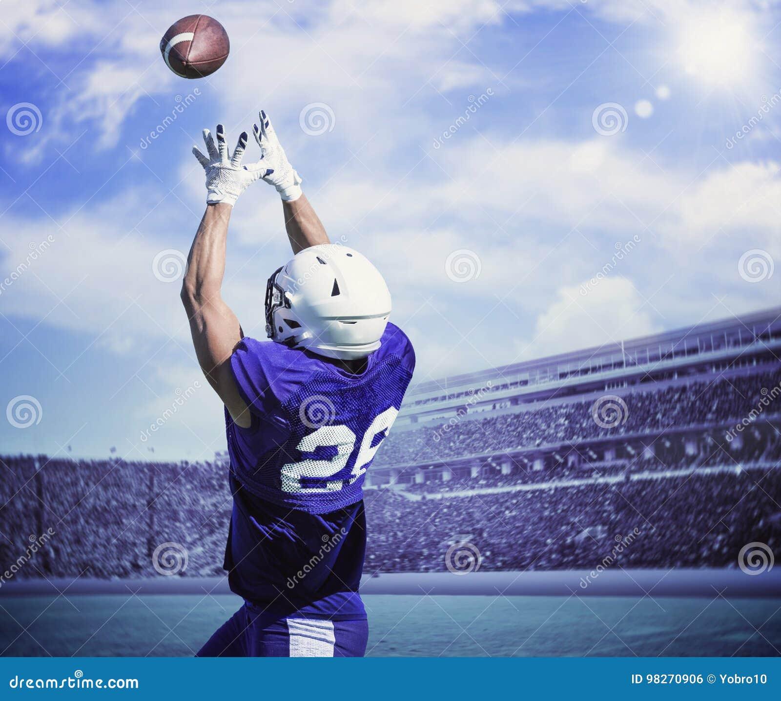 Jogador de futebol americano que trava uma passagem de aterrissagem