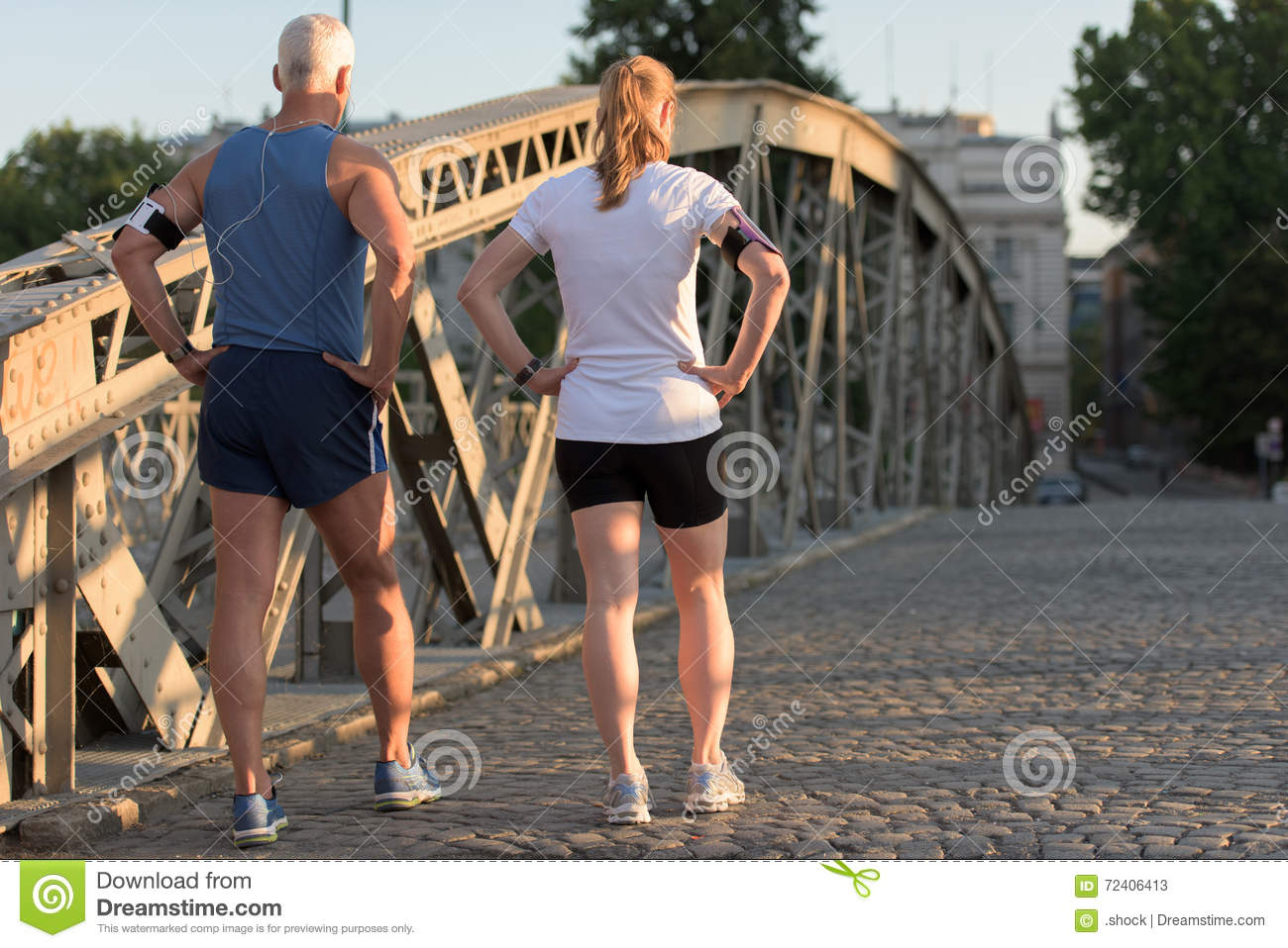 jogging couple planning running route and setting music stock image