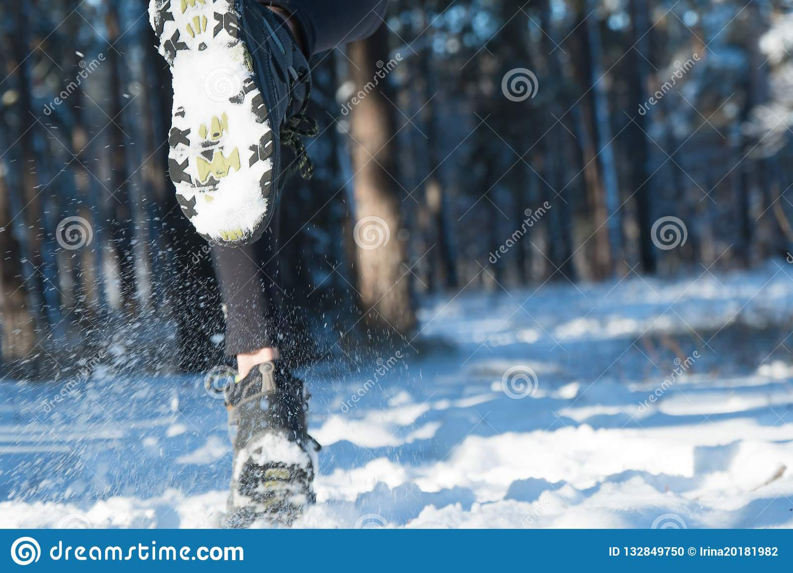 Jogging in winter. running through the snow. run forest snow