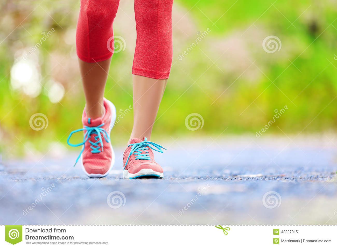 Jogging woman with athletic legs and running shoes