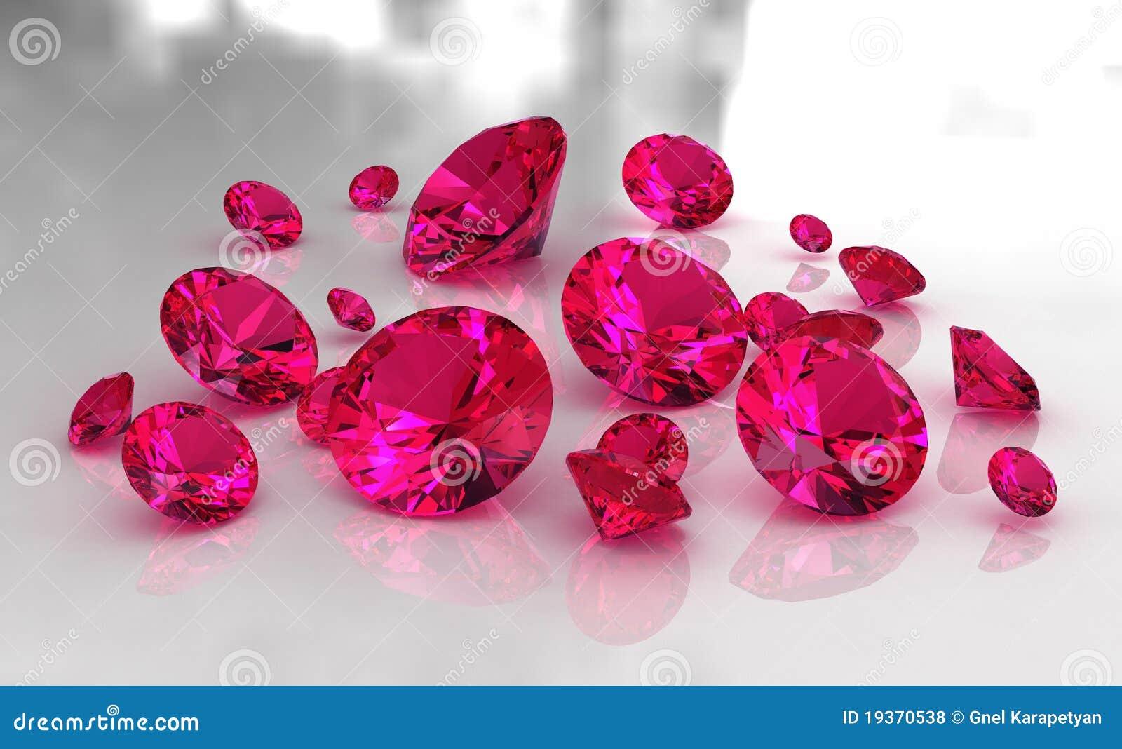 Jogo de pedras vermelhas redondas do rubi na superfície lustrosa