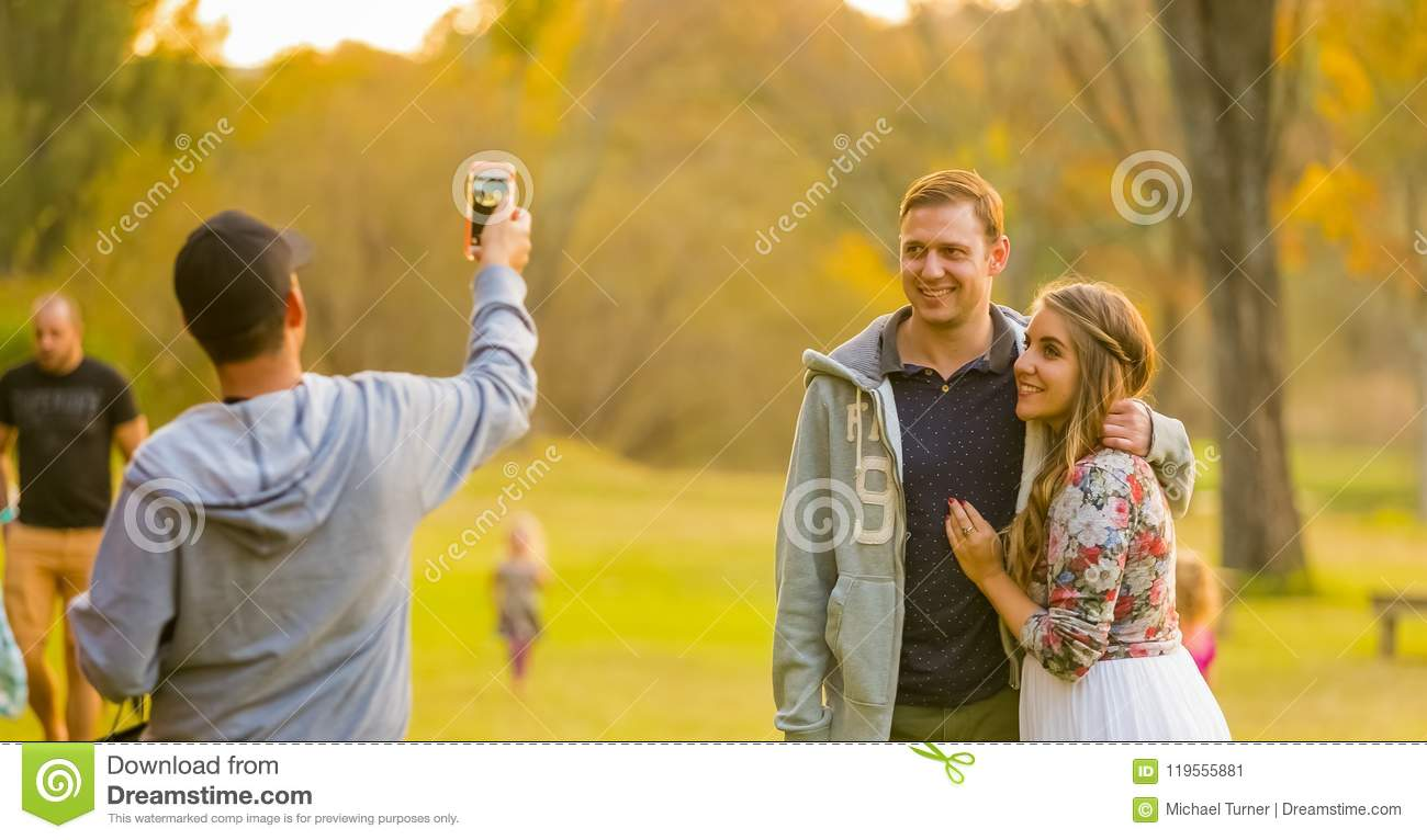 Young Beautiful Couple Posing For A Selfie At The Winter Sculptu