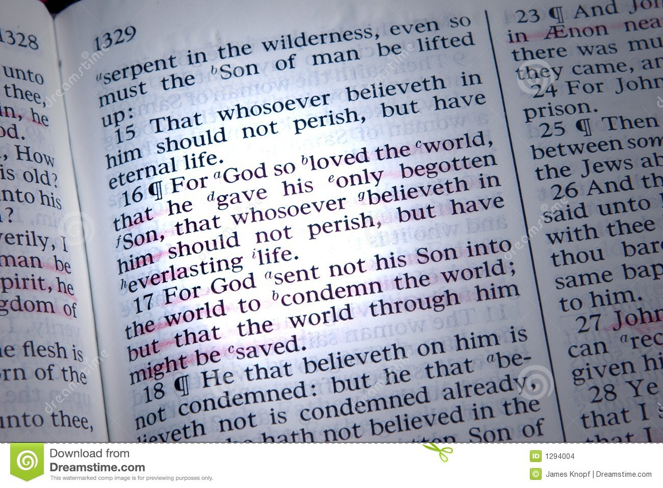 Bible is opened to John 3:16, highlighted by a beam of light.