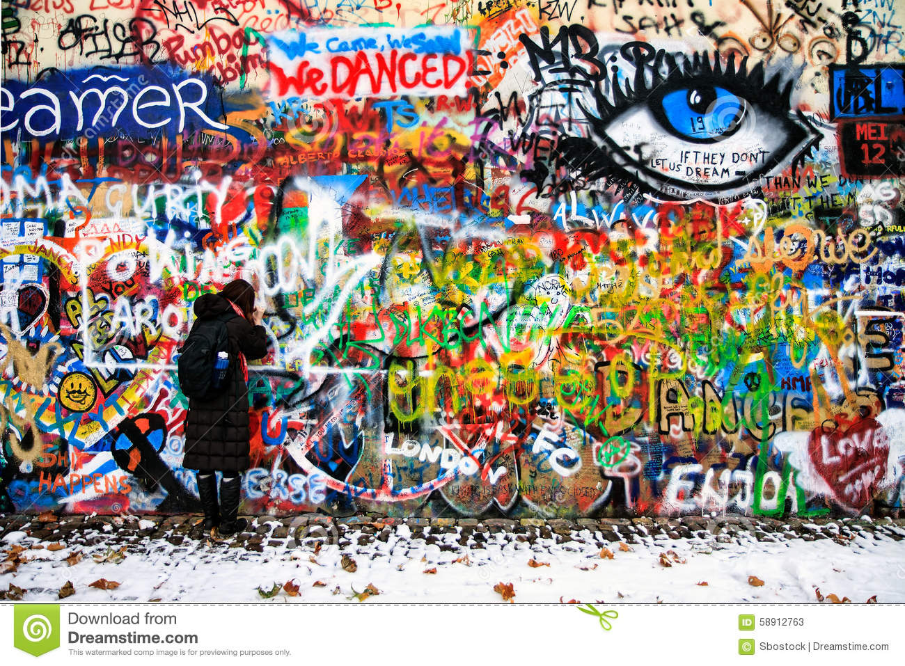 The lennon wall since the 1980s filled with john lennon inspired graffiti and pieces of lyrics from beatles songs prague czech republic