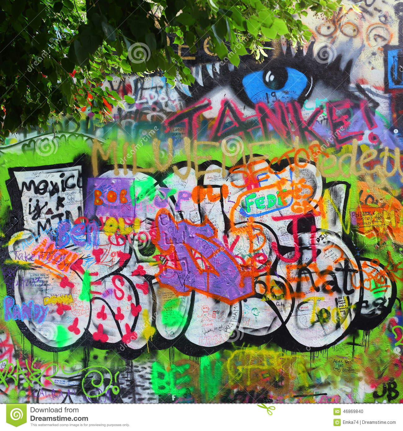 John lennon wall since the 1980s filled with john lennon inspired graffiti and pieces of lyrics from beatles songs on october 21 2010 in prague