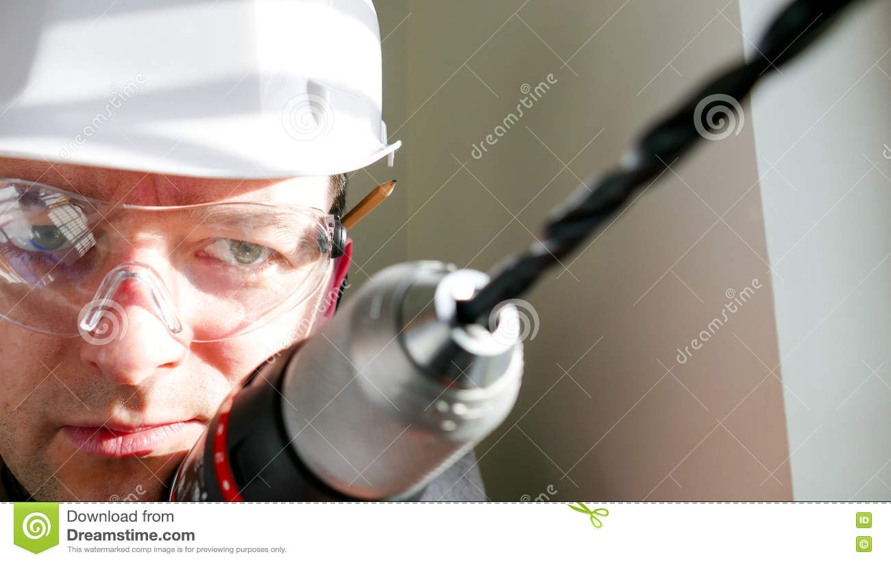 Download Joiner - Handyman Drilling In The Wall Stock Image - Image of repairman, craft: 71379211