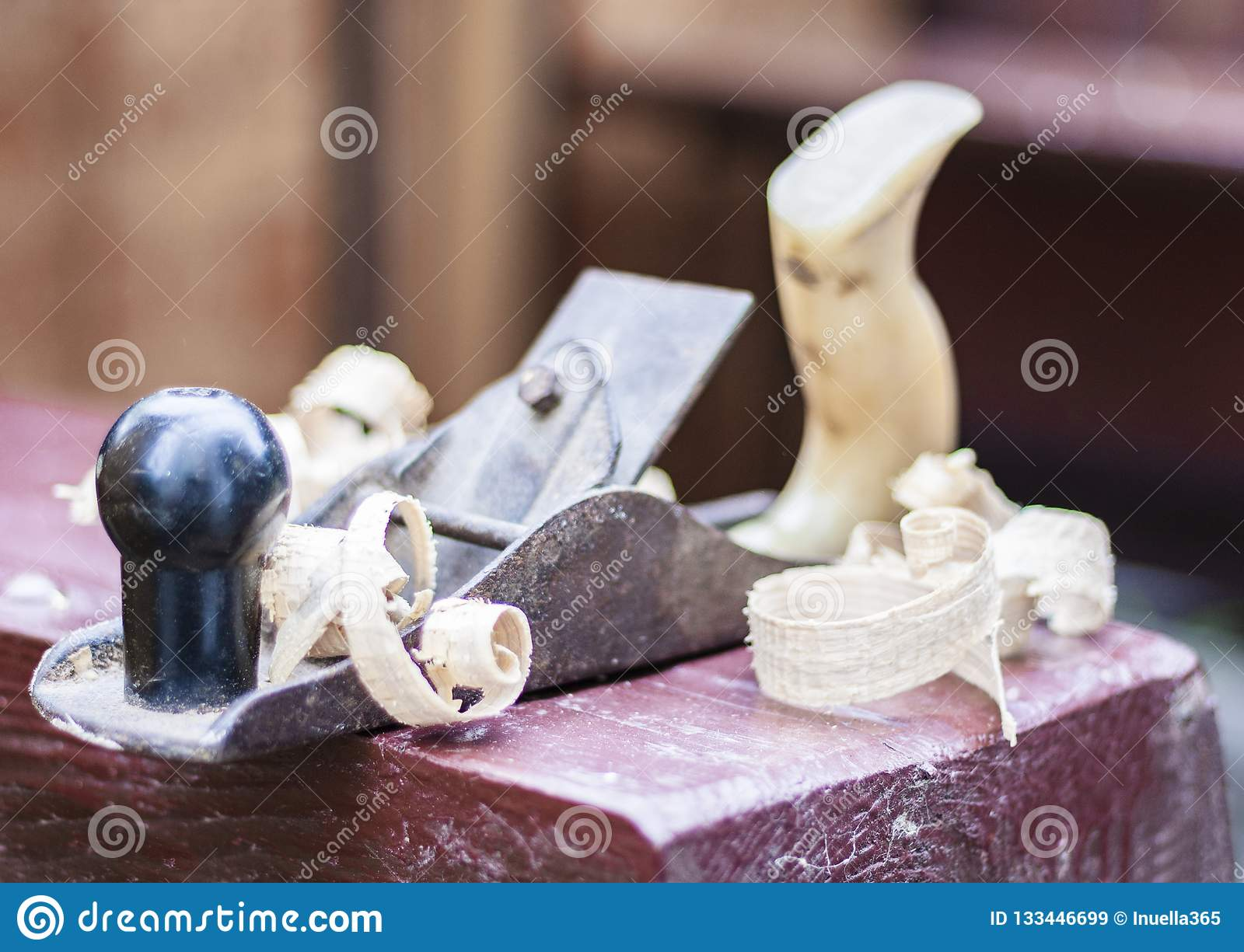 Joinery – old wooden plane and chips in a workshop of the carpenter
