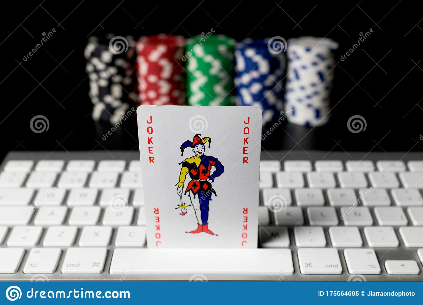 Joker Poker Card On A Computer Keyboard With Poker Chips Placed In Columns Unfocused On The Background Isolated On Black Editorial Image Image Of Computer Luck 175564605