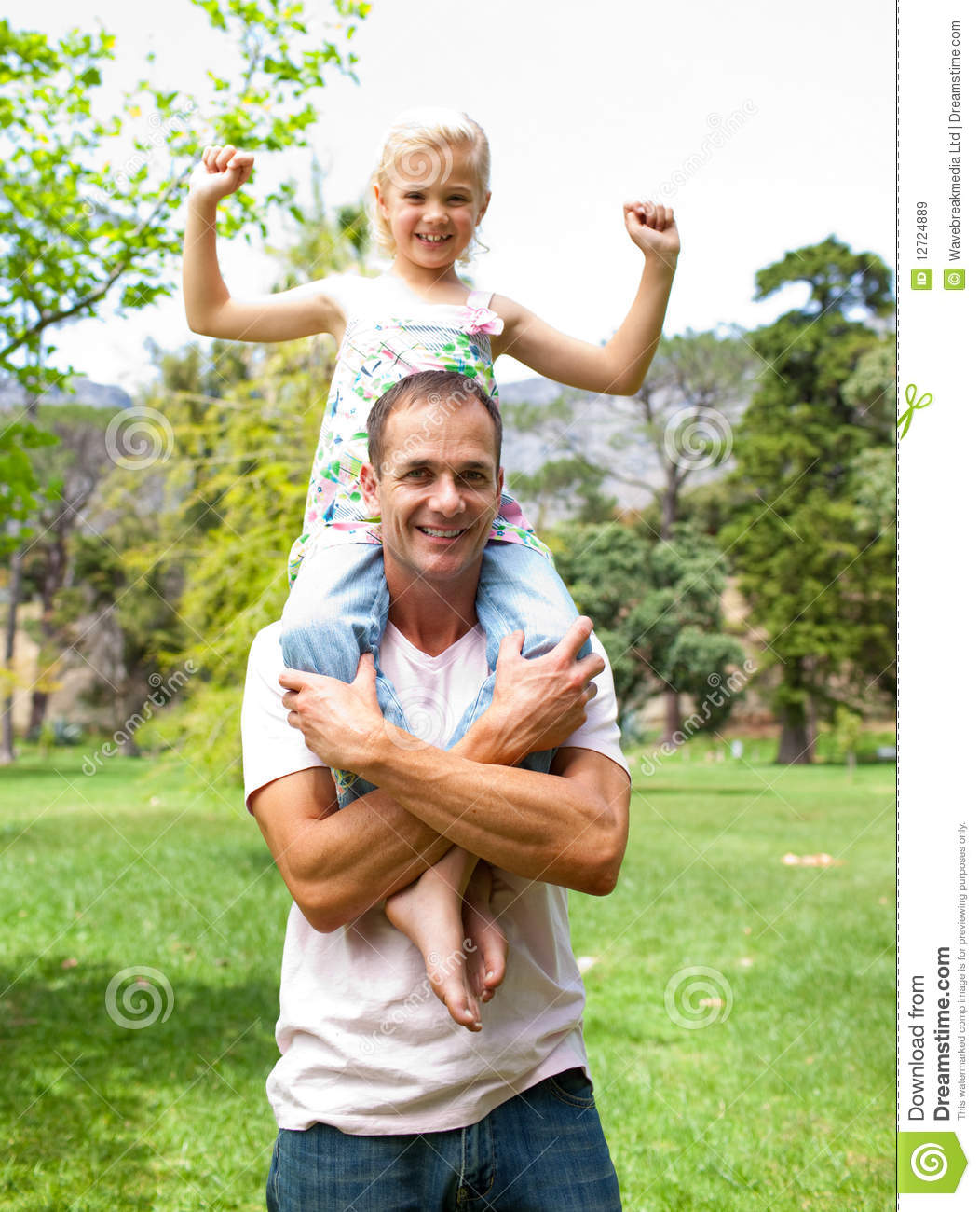 Jolly Father Giving His Daughter Piggy-back Ride Stock