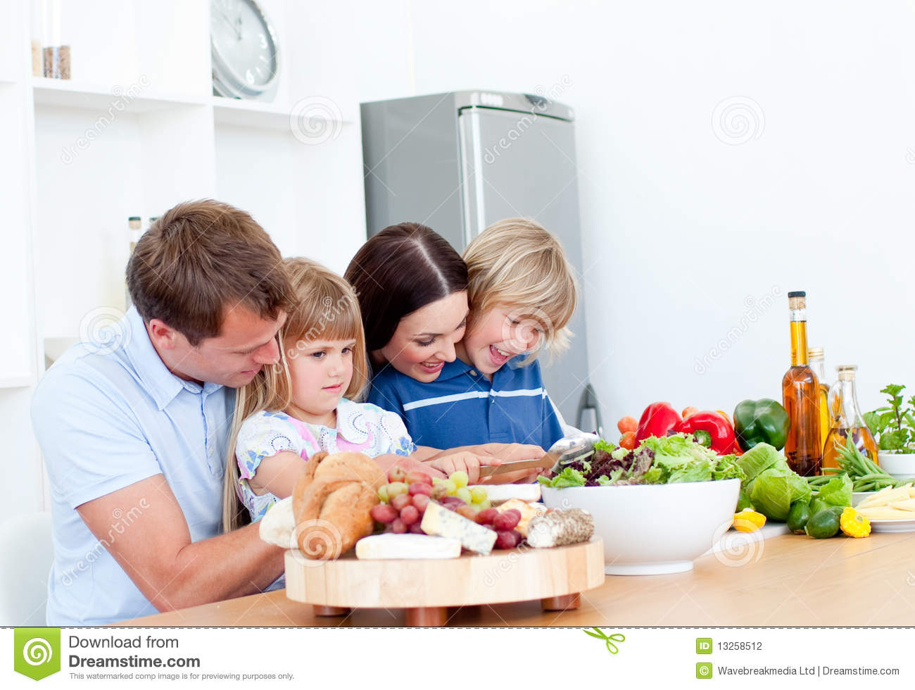 Family cooking kitchen - Jolly Young Family Cooking Together Stock Photography