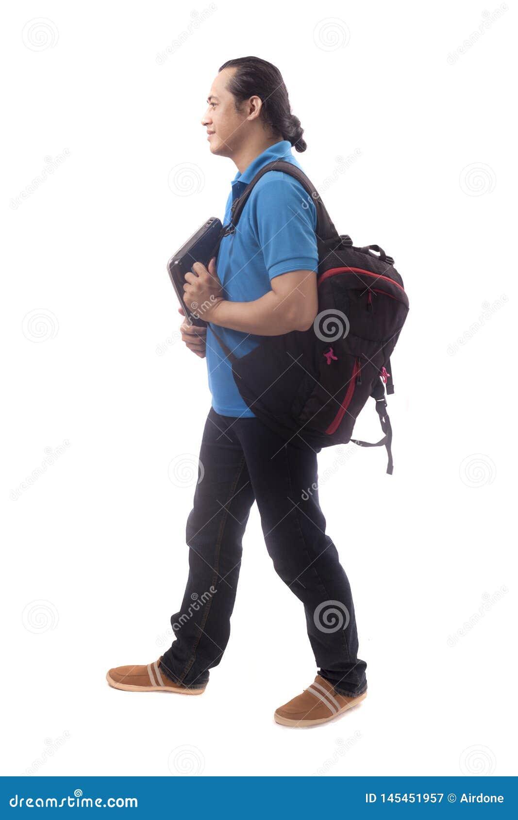 Jonge Student Walking Forward Isolated op Wit