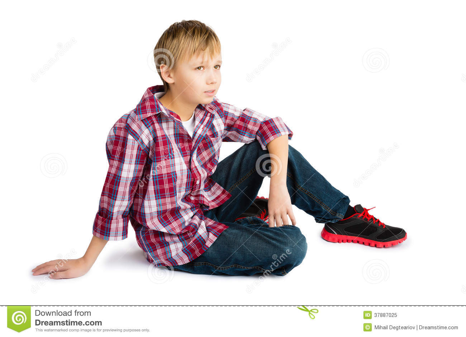 Jongen in Jeans en Geruit Overhemd
