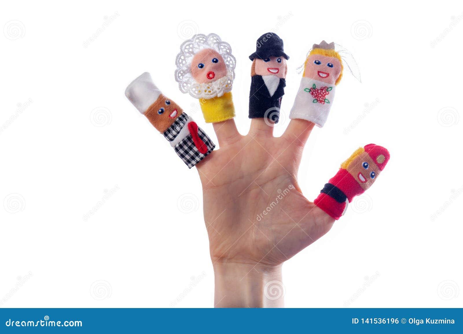 Jouets de doigt sur la main Fond blanc d isolement