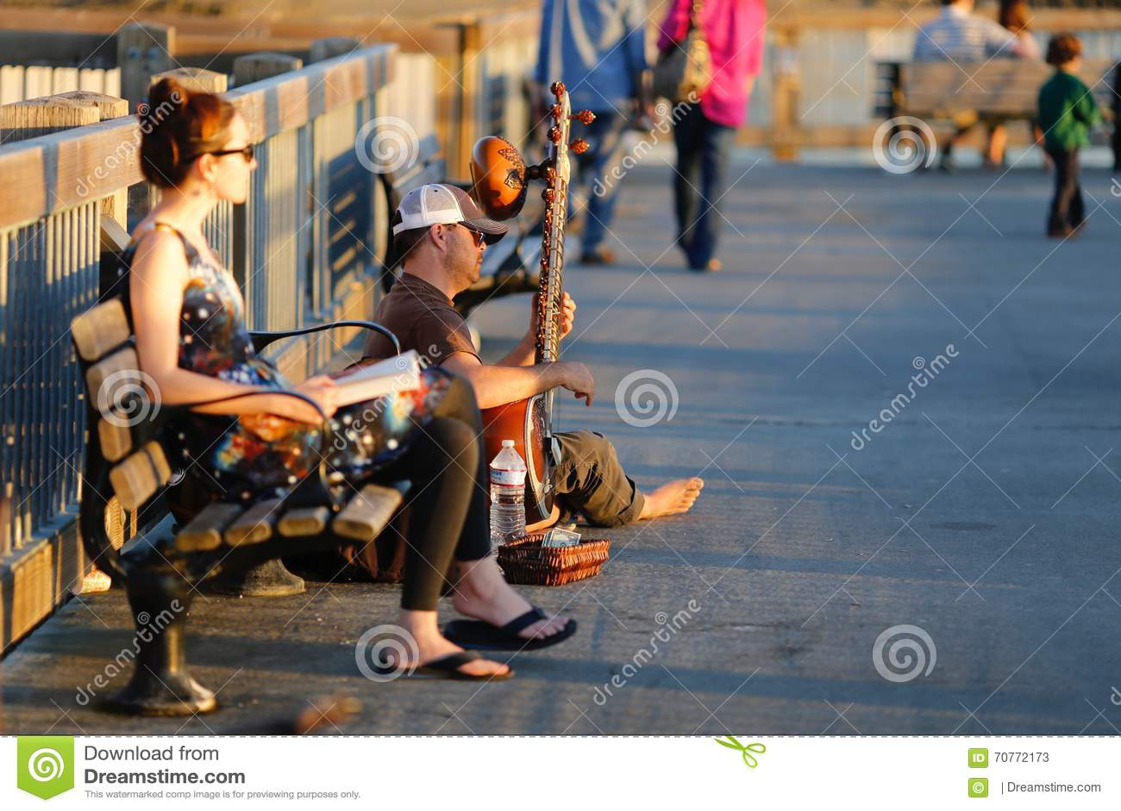 Joueur de banjo sur la promenade