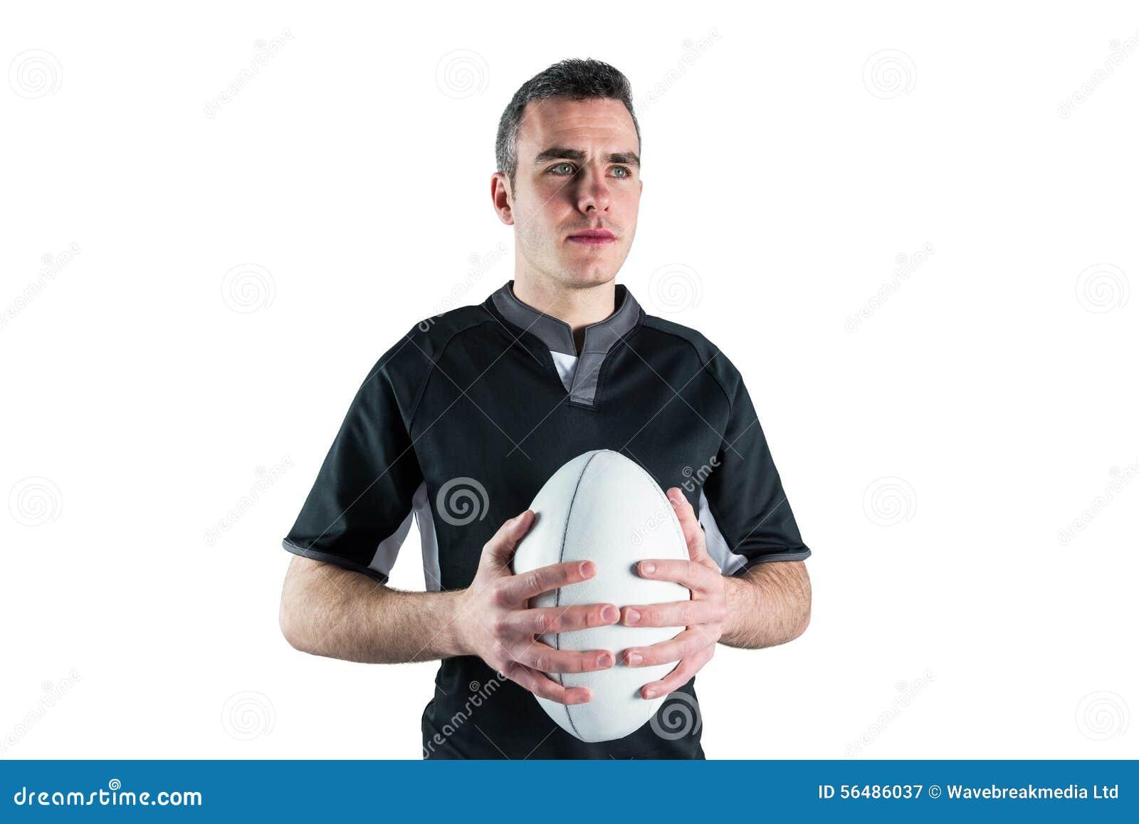 Joueur de rugby tenant une boule de rugby