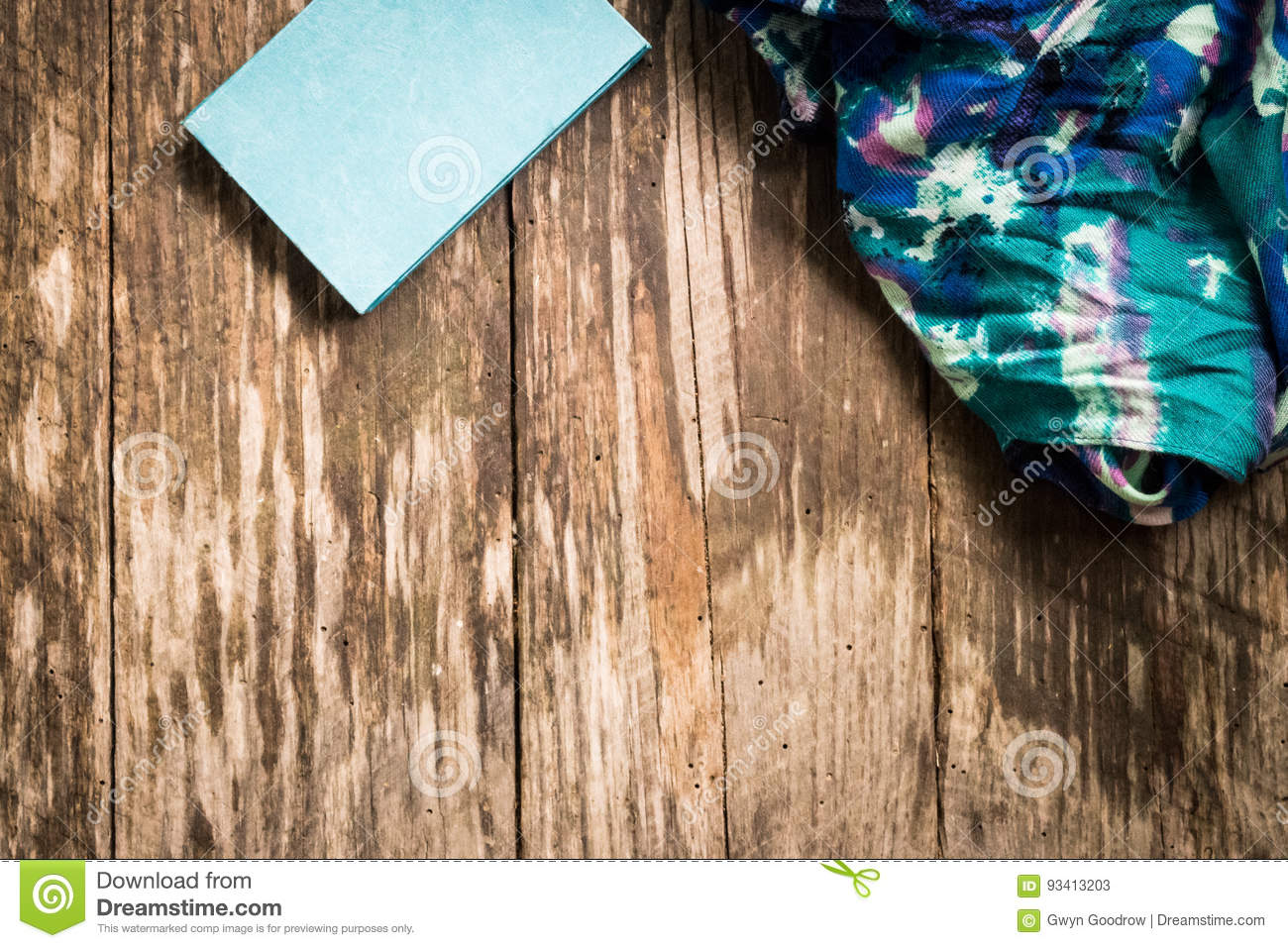 Journal and Scarf Fabric against wood background
