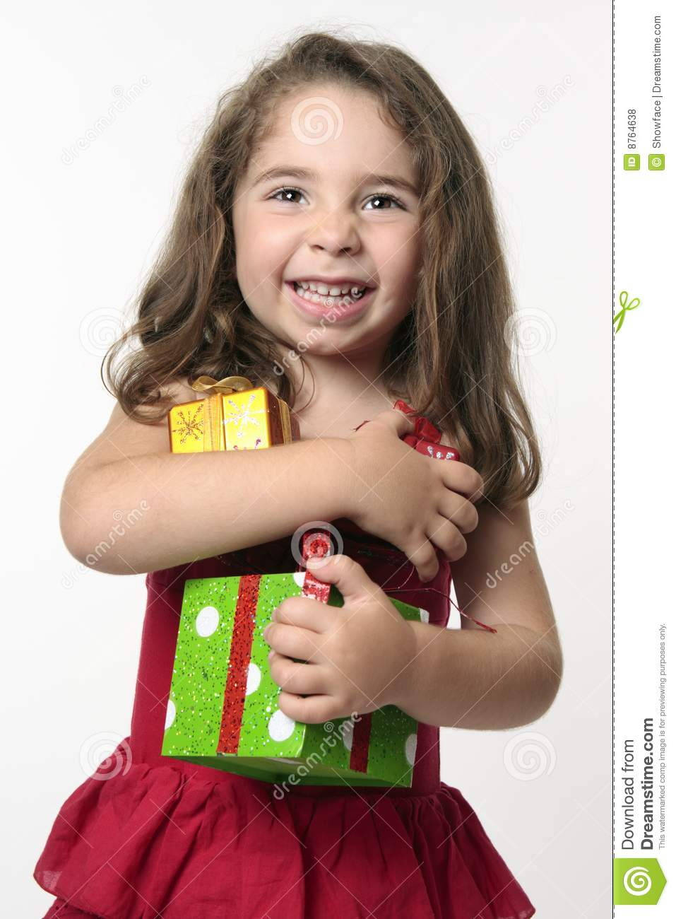 Jovial Happy Girl Child Holding Presents Royalty Free
