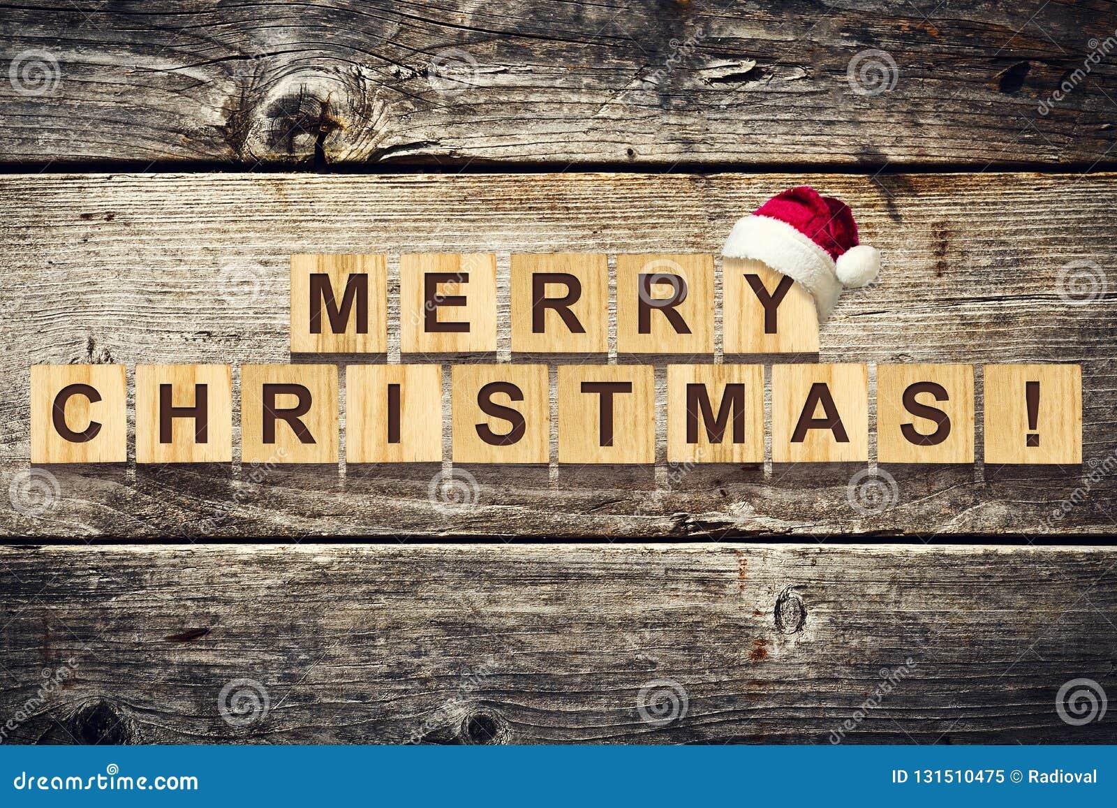 Joyeux Noël Mots composés de l alphabet sur les cubes en bois Fond en bois Fond de Noël