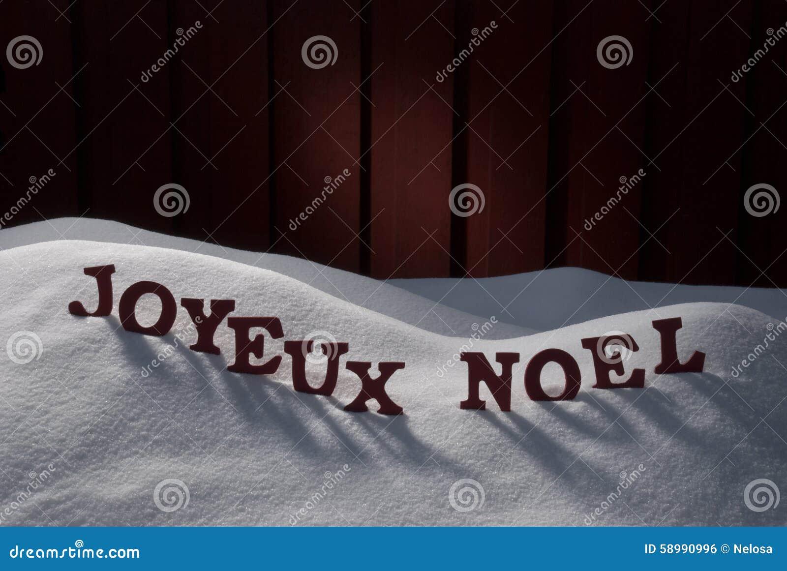 joyeux noel means merry christmas on snow stock photo. Black Bedroom Furniture Sets. Home Design Ideas