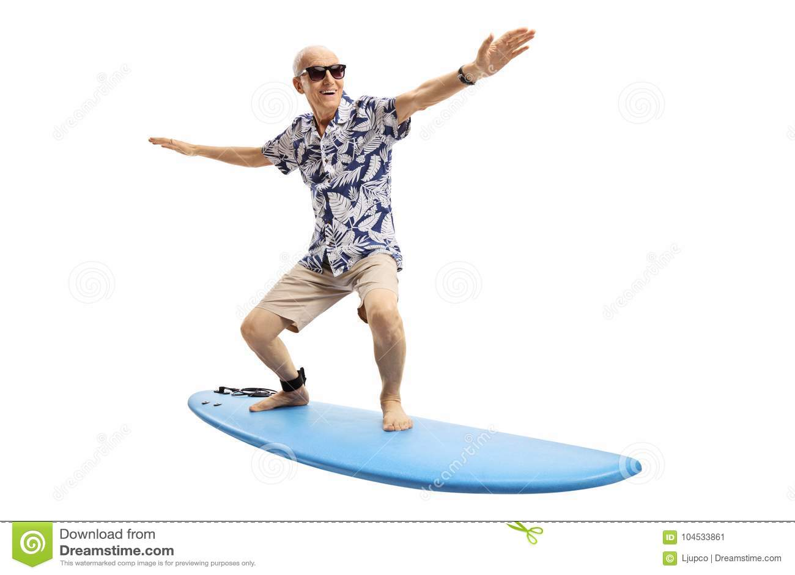 Joyful elderly man surfing