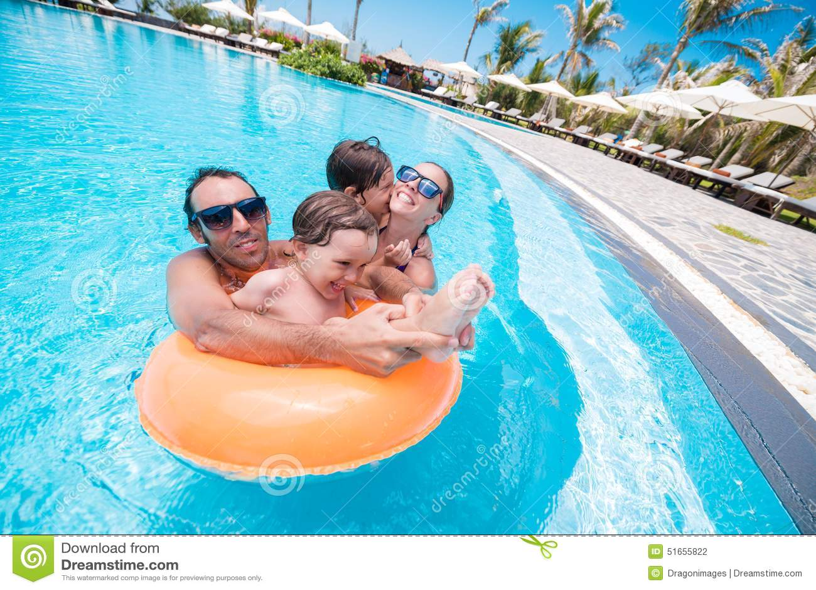 Joyful family in the pool
