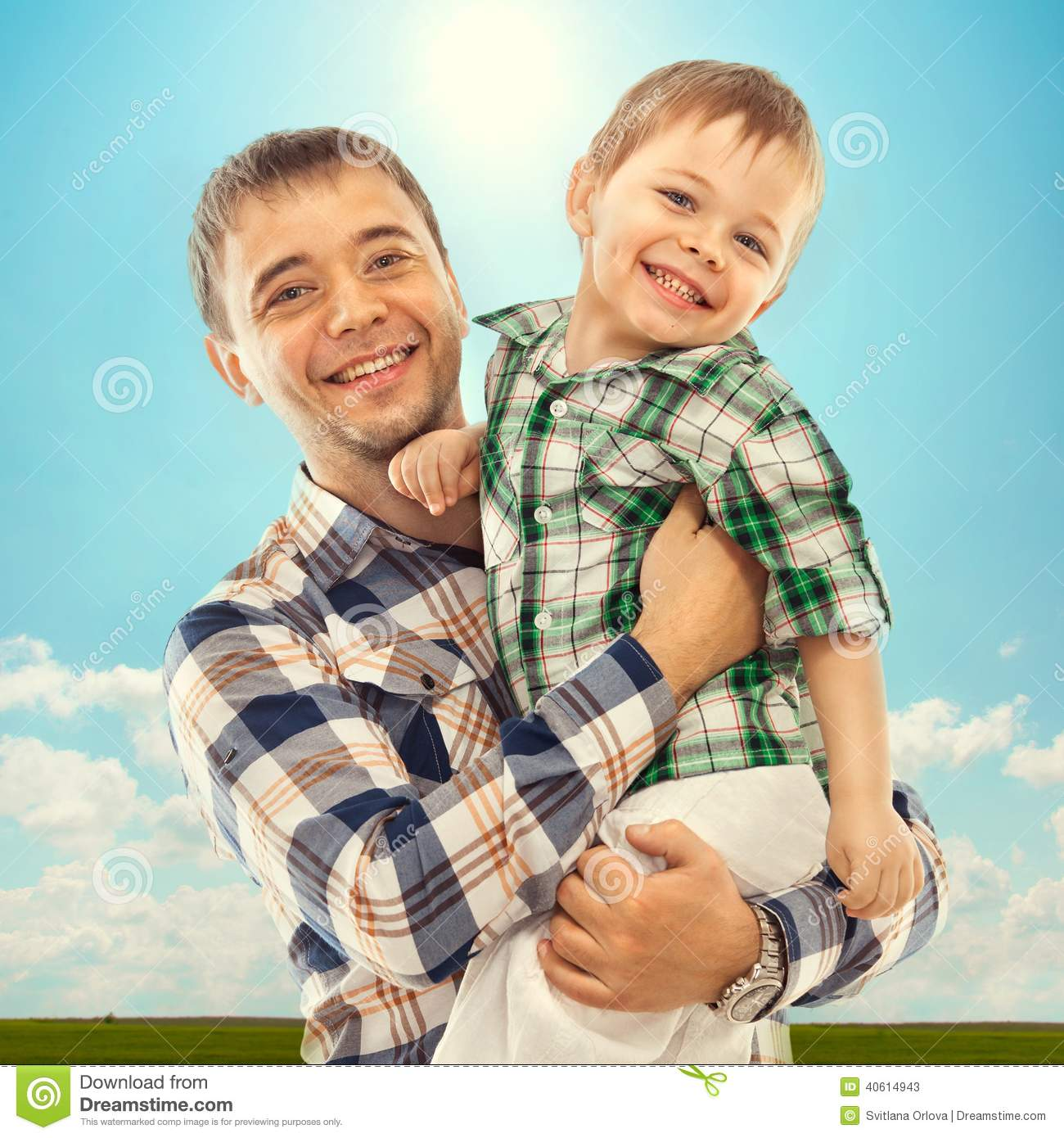 Joyful father with son carefree and happy