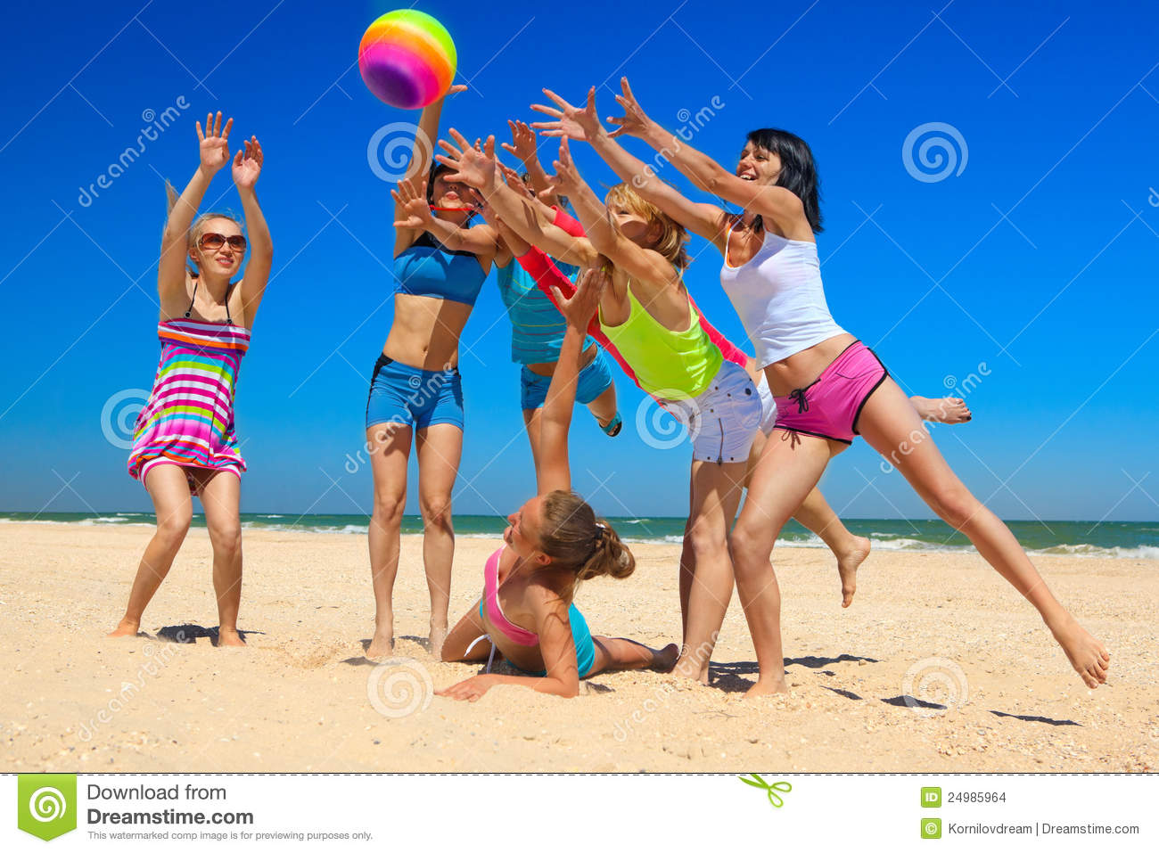 Group Of Young Joyful People Playing Volleyball On The